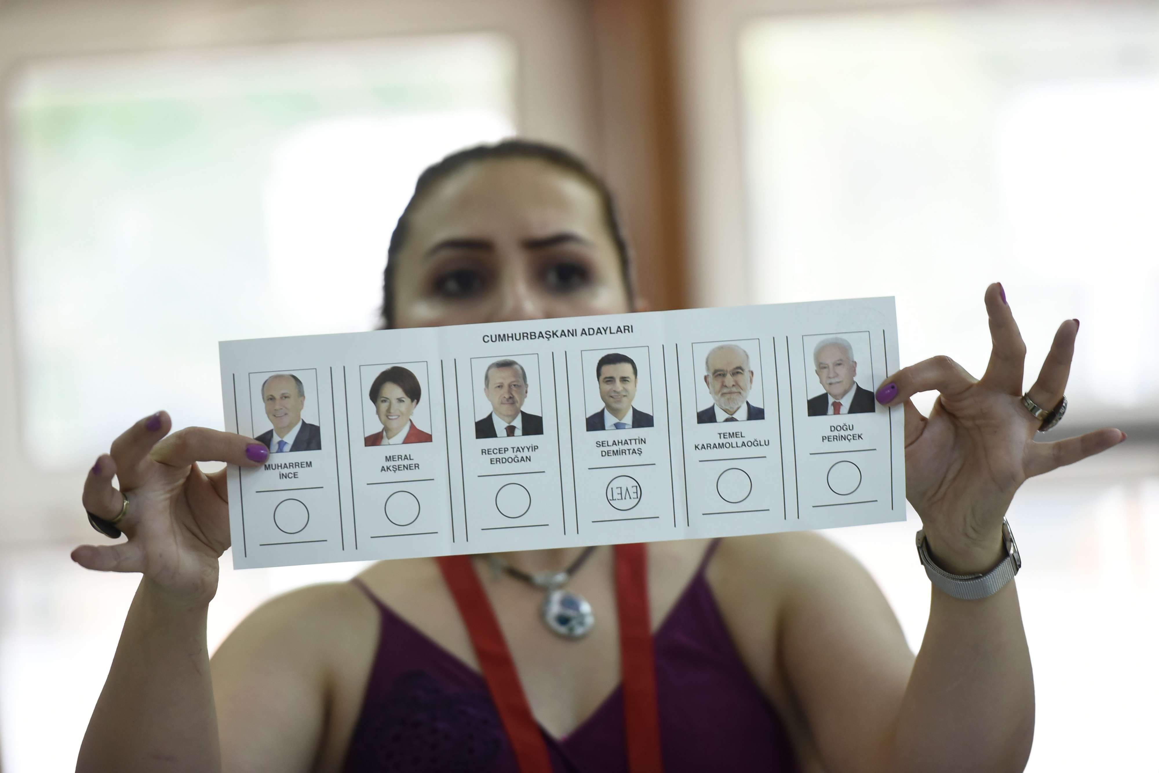 Against all odds. An election committee member shows a ballot displaying a vote for Selahattin Demirtas, presidential candidate of the pro-Kurdish Peoples' Democratic Party (HDP) at a polling station in Istanbul, on June 24, 2018.  (AFP)