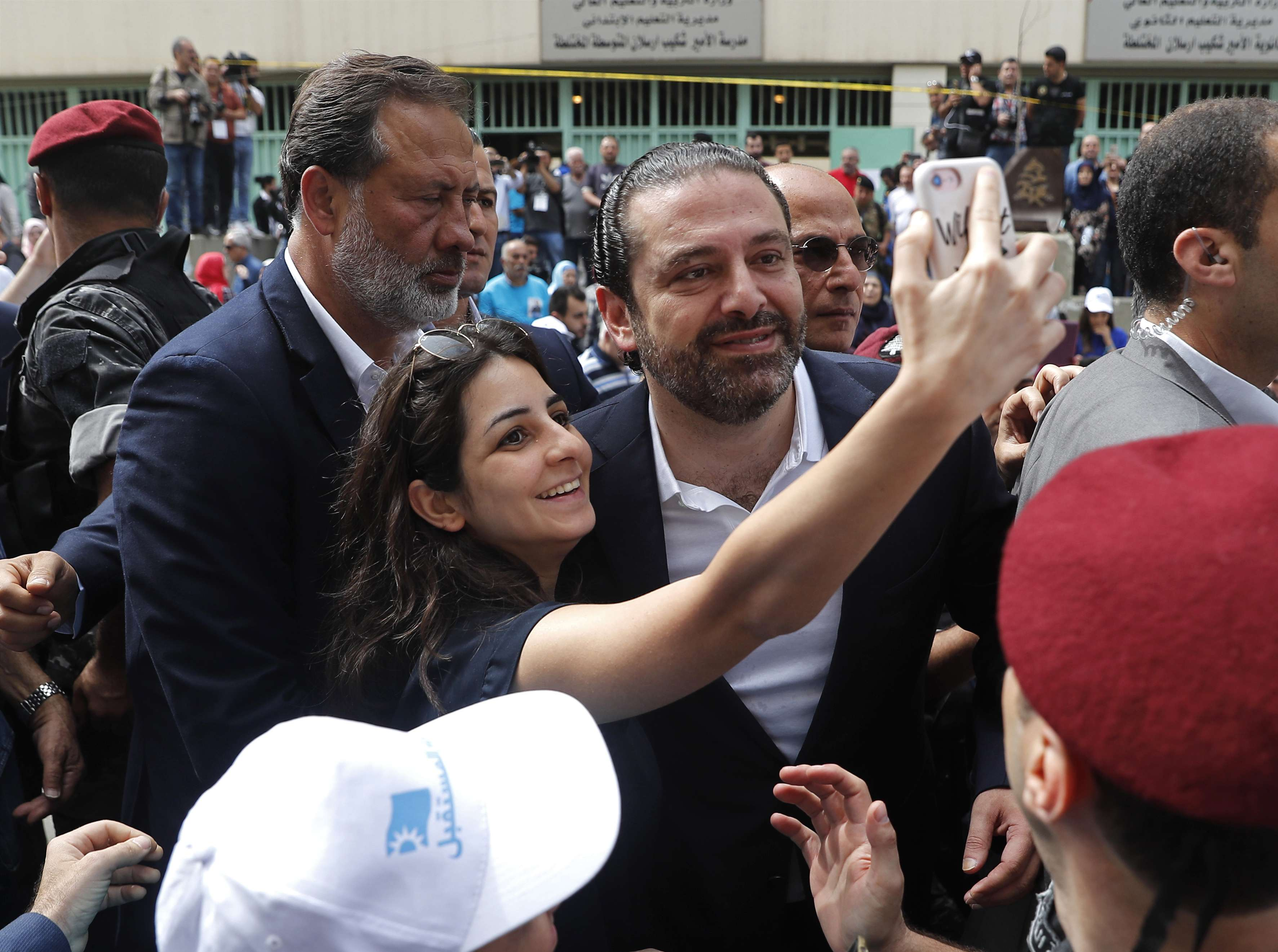 Changed view. A supporter of Lebanese Prime Minister Saad Hariri 5c° takes a selfie with him in Beirut. (AP)
