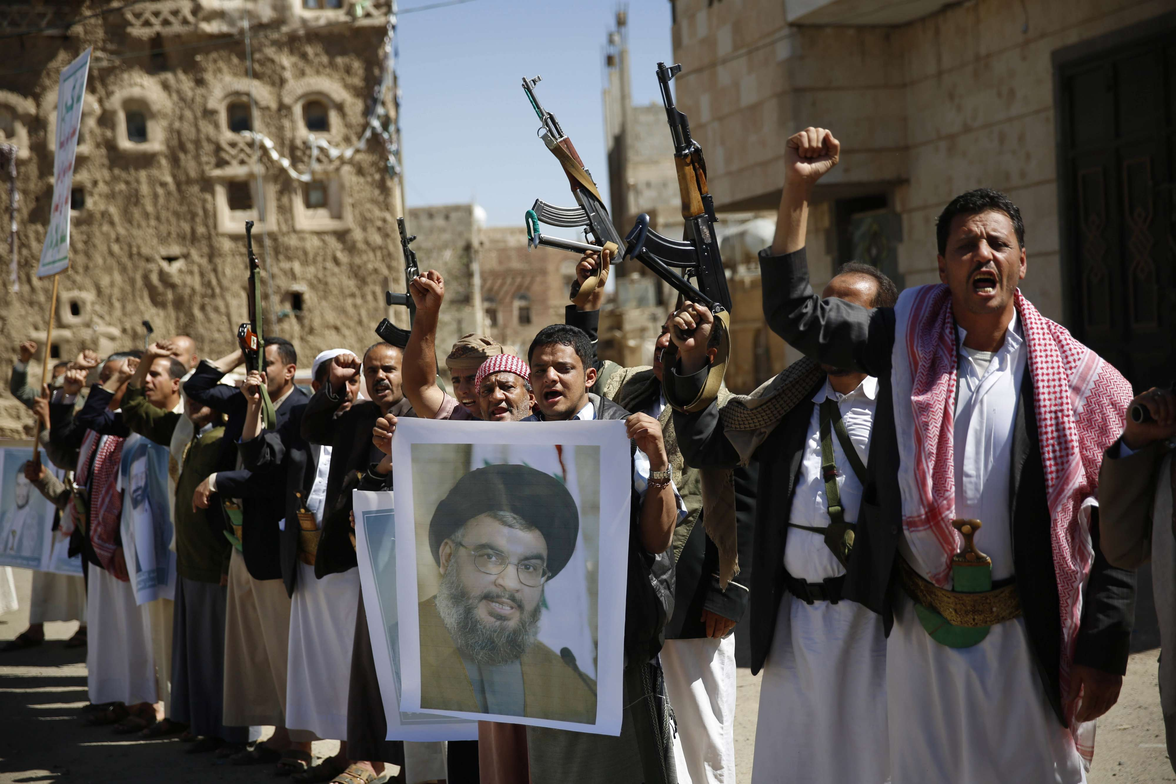 Dangerous mix. Shia Houthi rebels hold a poster of Hezbollah  leader Sayyed Hassan Nasrallah during a rally in Sana'a.  (AP)