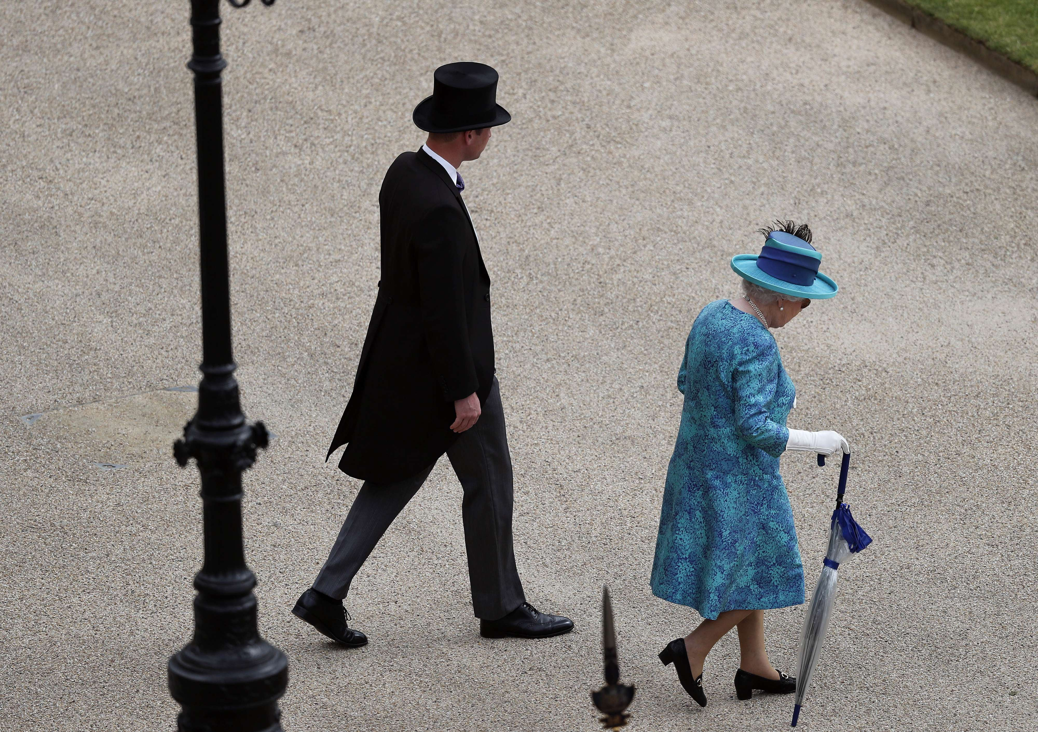 Britain's Queen Elizabeth II (L) and Prince William arrive as she hosts a Garden Party at Buckingham Palace in London, on May 31. (AP)
