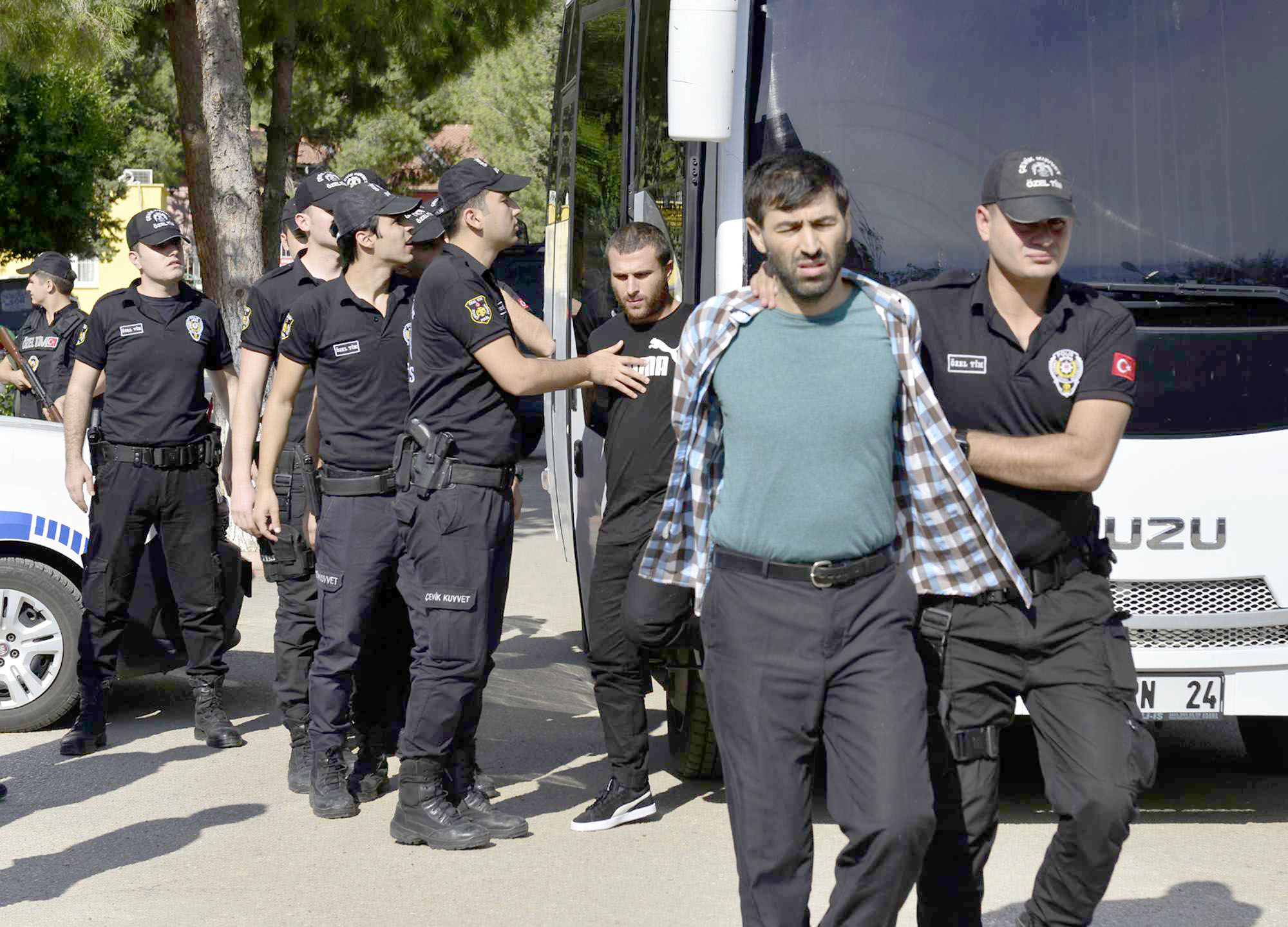 Turkish police officers escort men, suspected of being ISIS members, at a court in Adana in southern Turkey, last November. (AP)