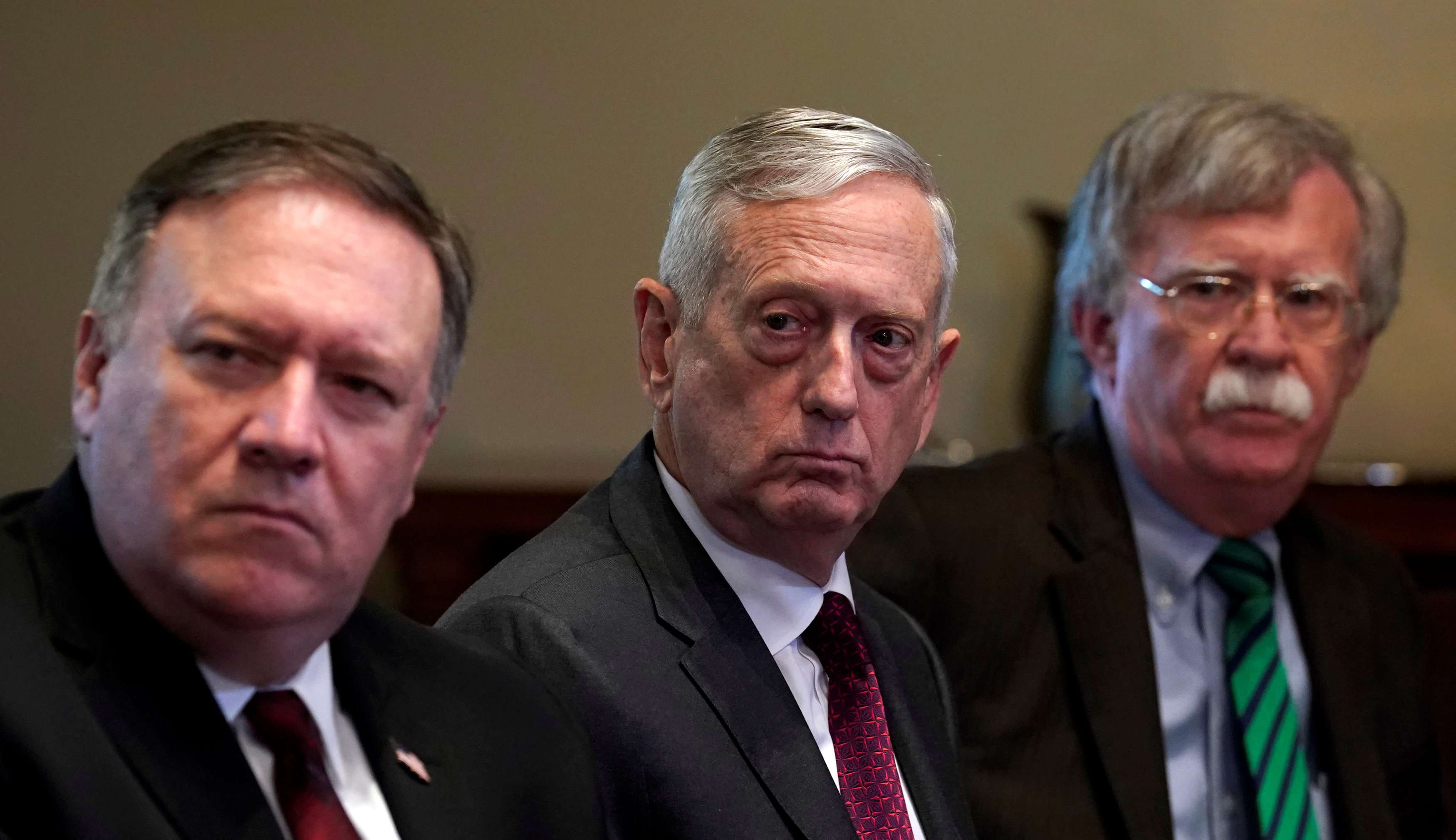 Capricious unilateralism. (L-R) US Secretary of State Mike Pompeo, Secretary of Defence James Mattis and National Security Adviser John Bolton attend a meeting at the White House, on May 17. (Reuters)