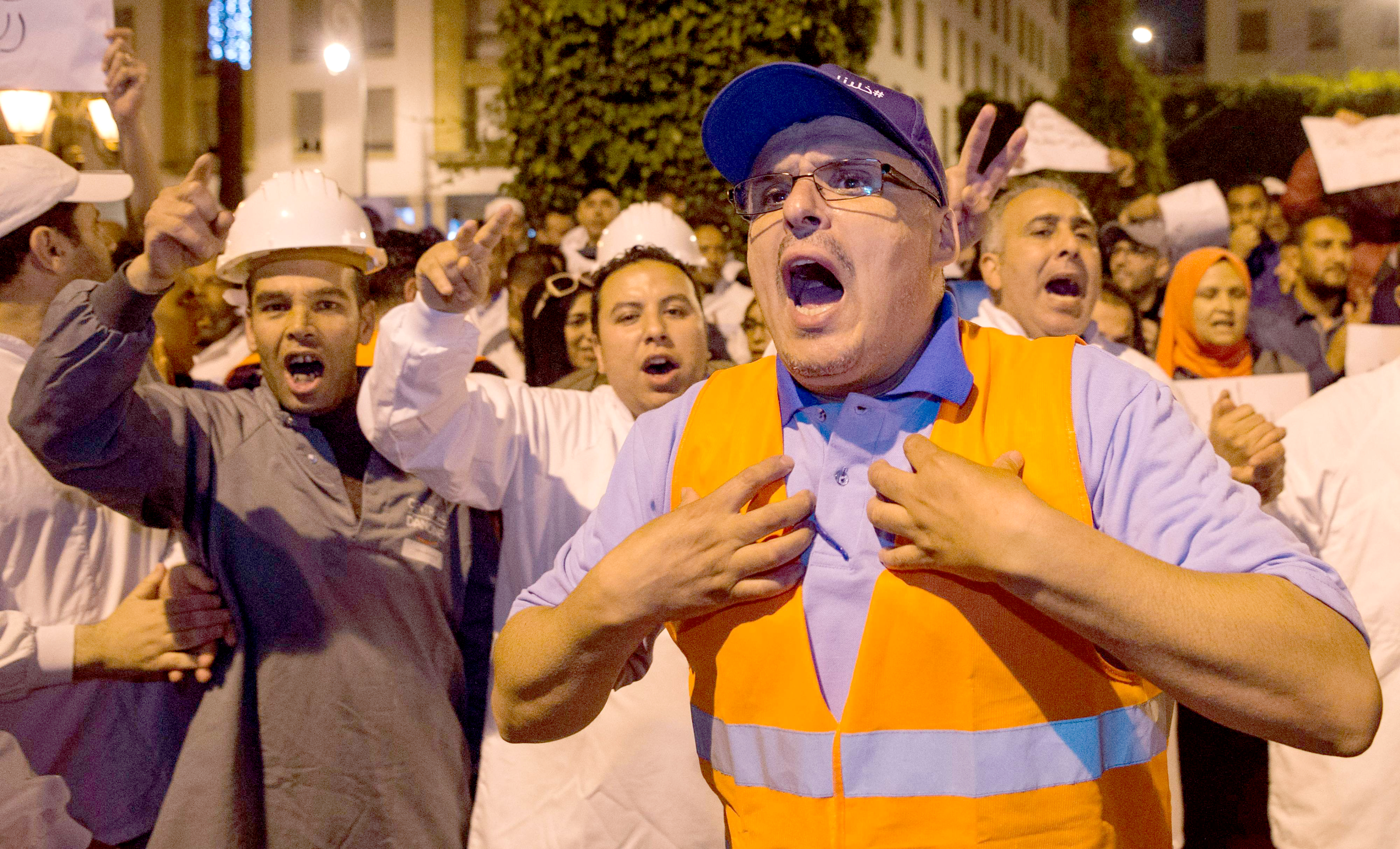 Workers of the Centrale Danone company protest against the boycott of the brand in front of parliament in Rabat, on June 5. (AFP)