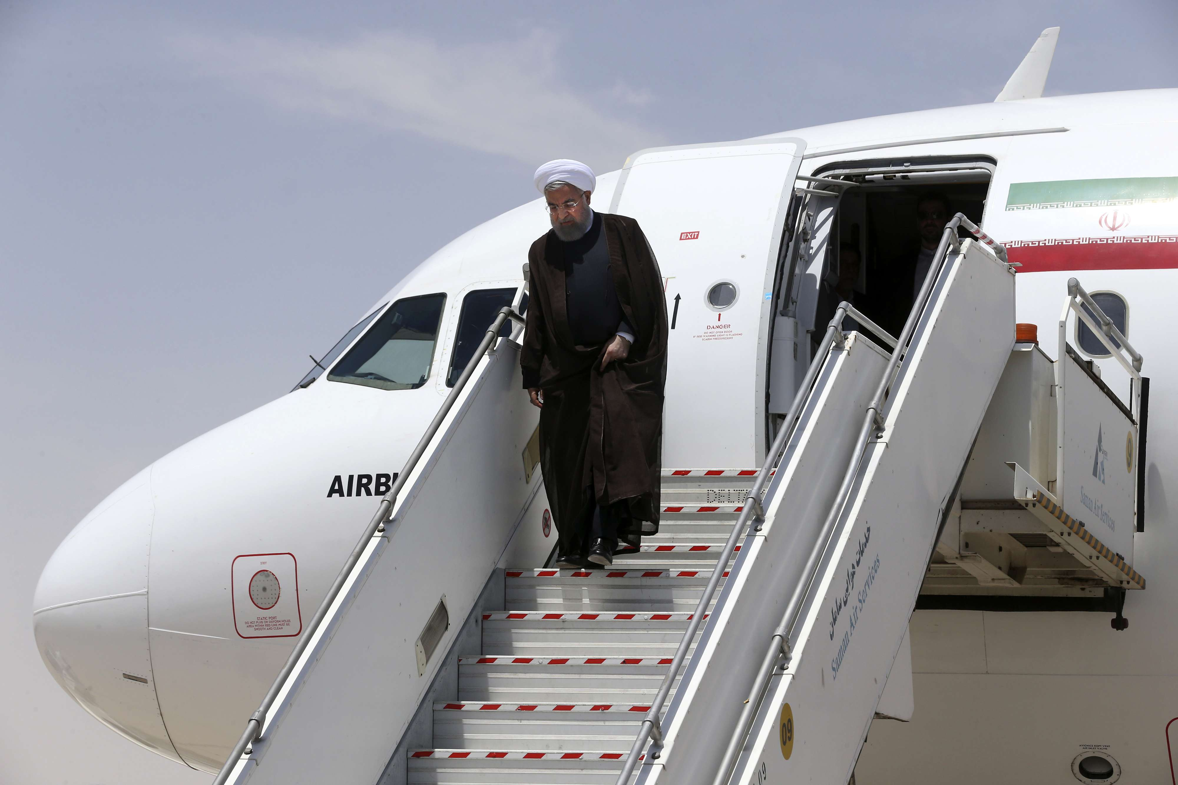 Iranian President Hassan Rohani steps out of his plane upon arrival at the Shahid Beheshti airport in the city of Isfahan, on May 14. (AP)