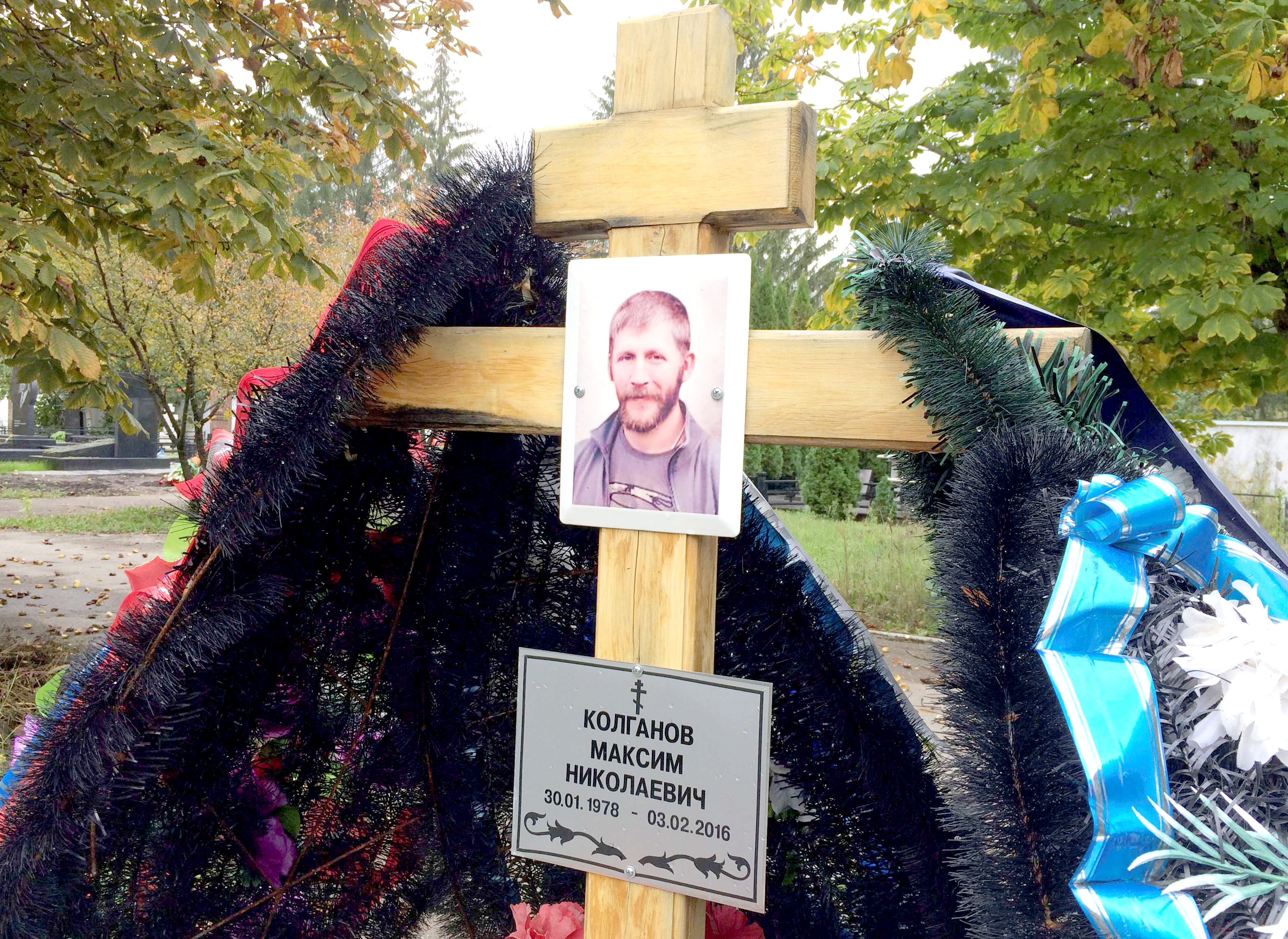 A portrait of a Russian contractor who was killed in combat in Syria is seen at his grave in his home town of Togliatti in Russia. (Reuters)