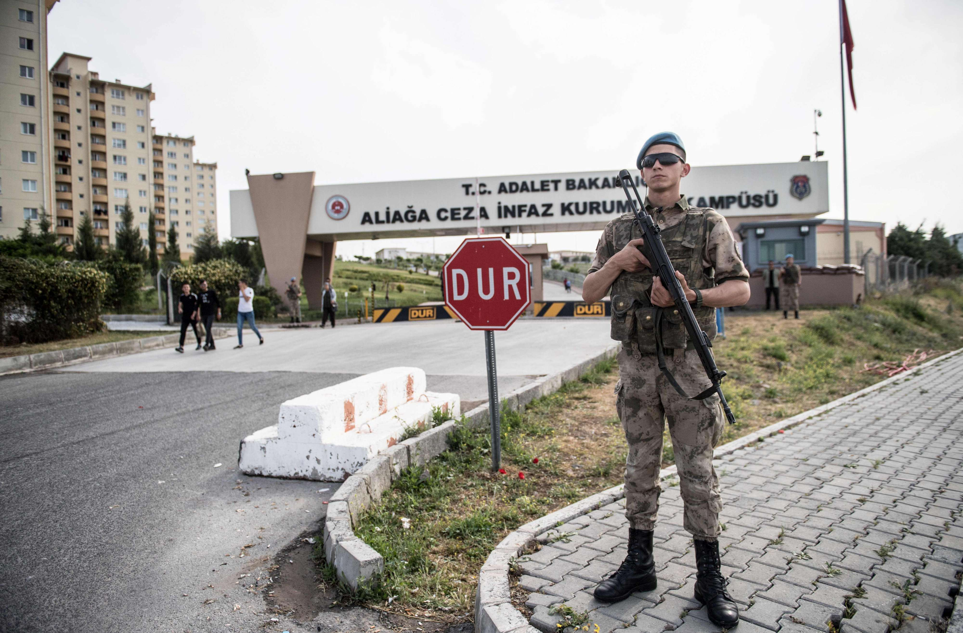 Turkish soldiers stand guard at the entrance of the Aliaga court and prison complex during the trial of US pastor Andrew Brunson, on May 7. (AFP)