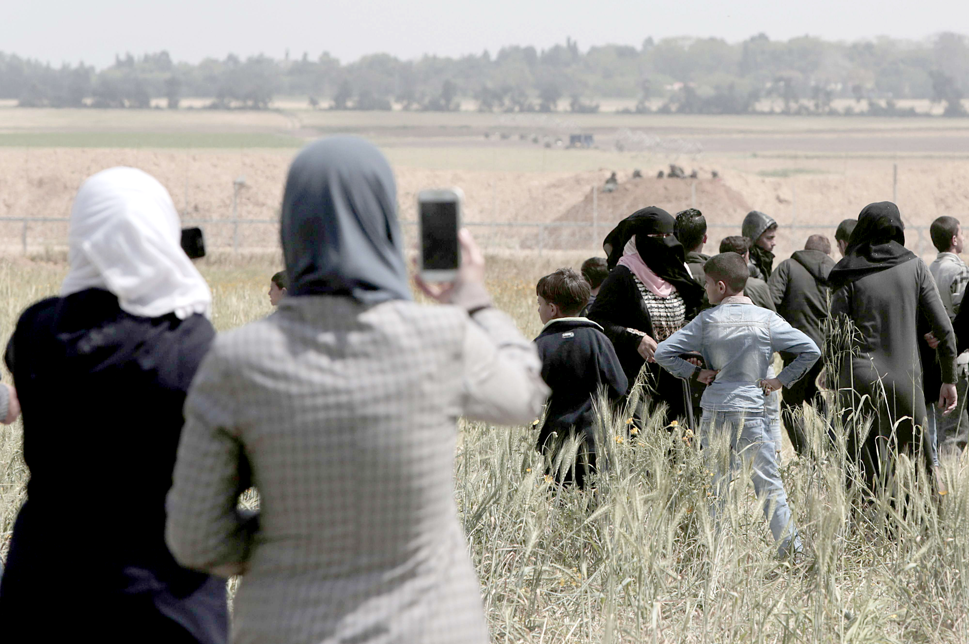 Capturing the violence. Palestinian women use their mobile phones to take photos during clashes with Israeli troops, last March. (AP)