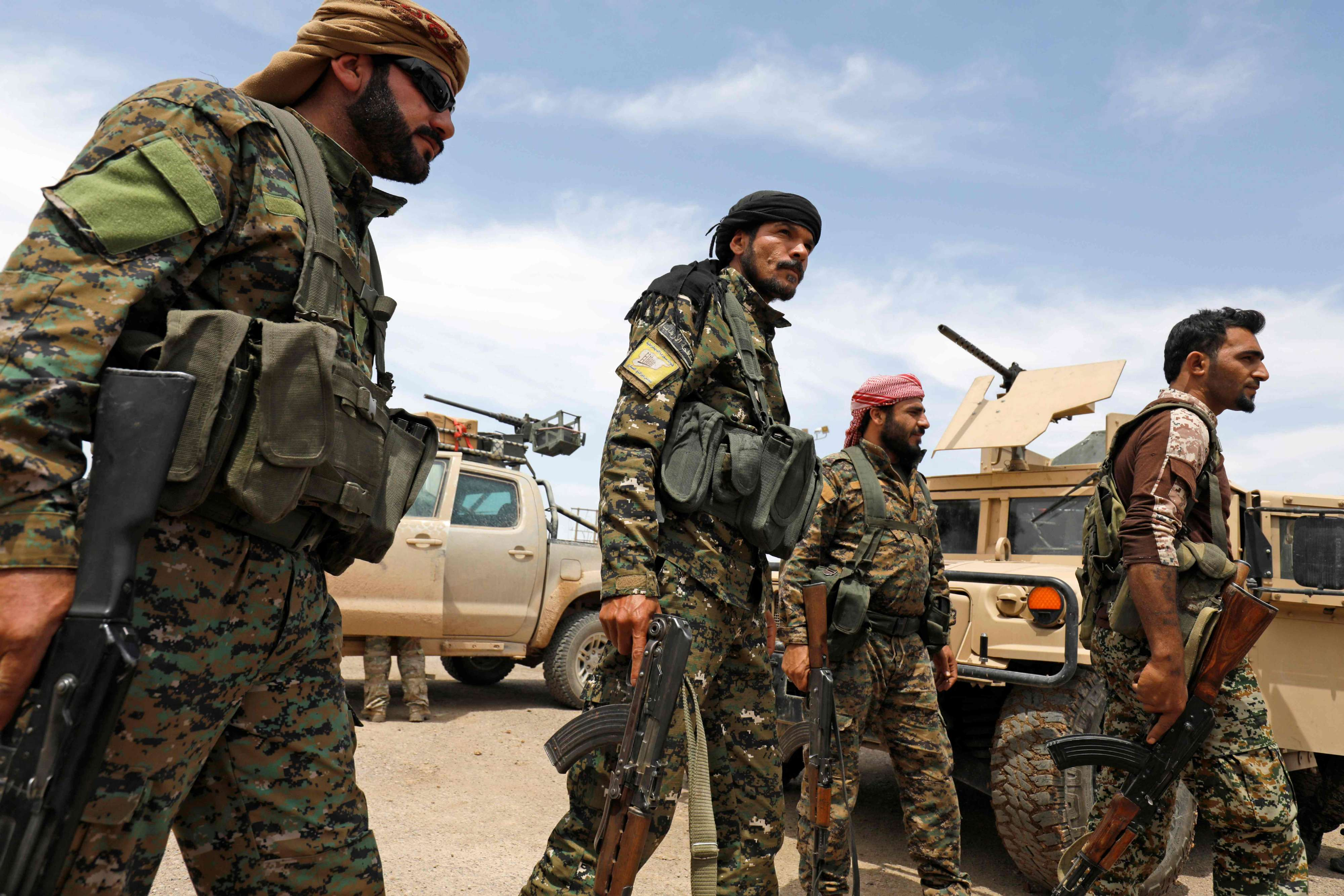 Members of the Syrian Democratic Forces (SDF) gather at the al-Tanak oil field as they prepare to relaunch a military campaign against Islamic State militants, near Abu Kamal, province of Deir Ezzor, in eastern Syria, on May 1. (AFP)