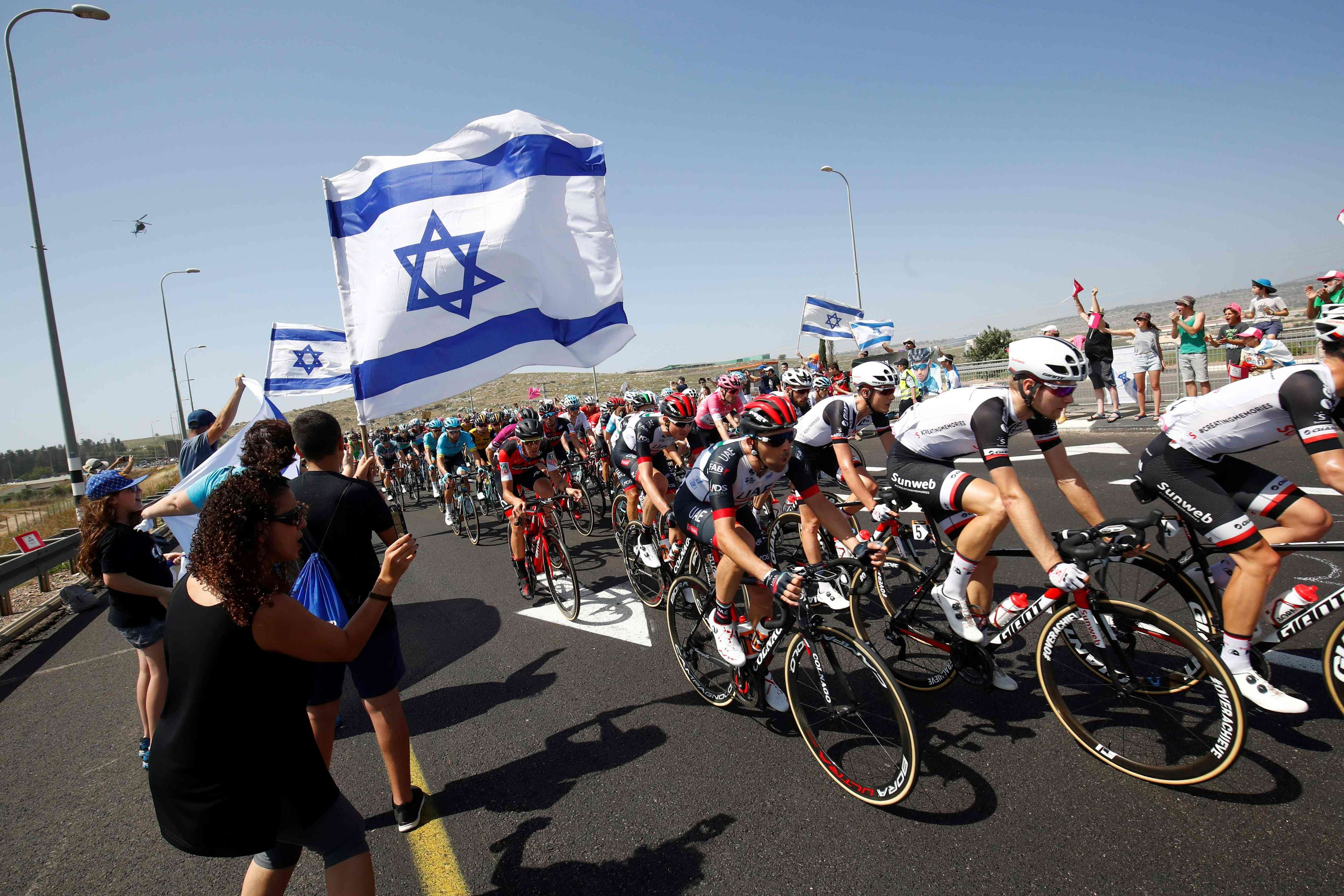 Israeli fans cheer for the riders during the second stage of the 101st Tour of Italy, between Haifa and Tel Aviv, on May 5. (AFP)