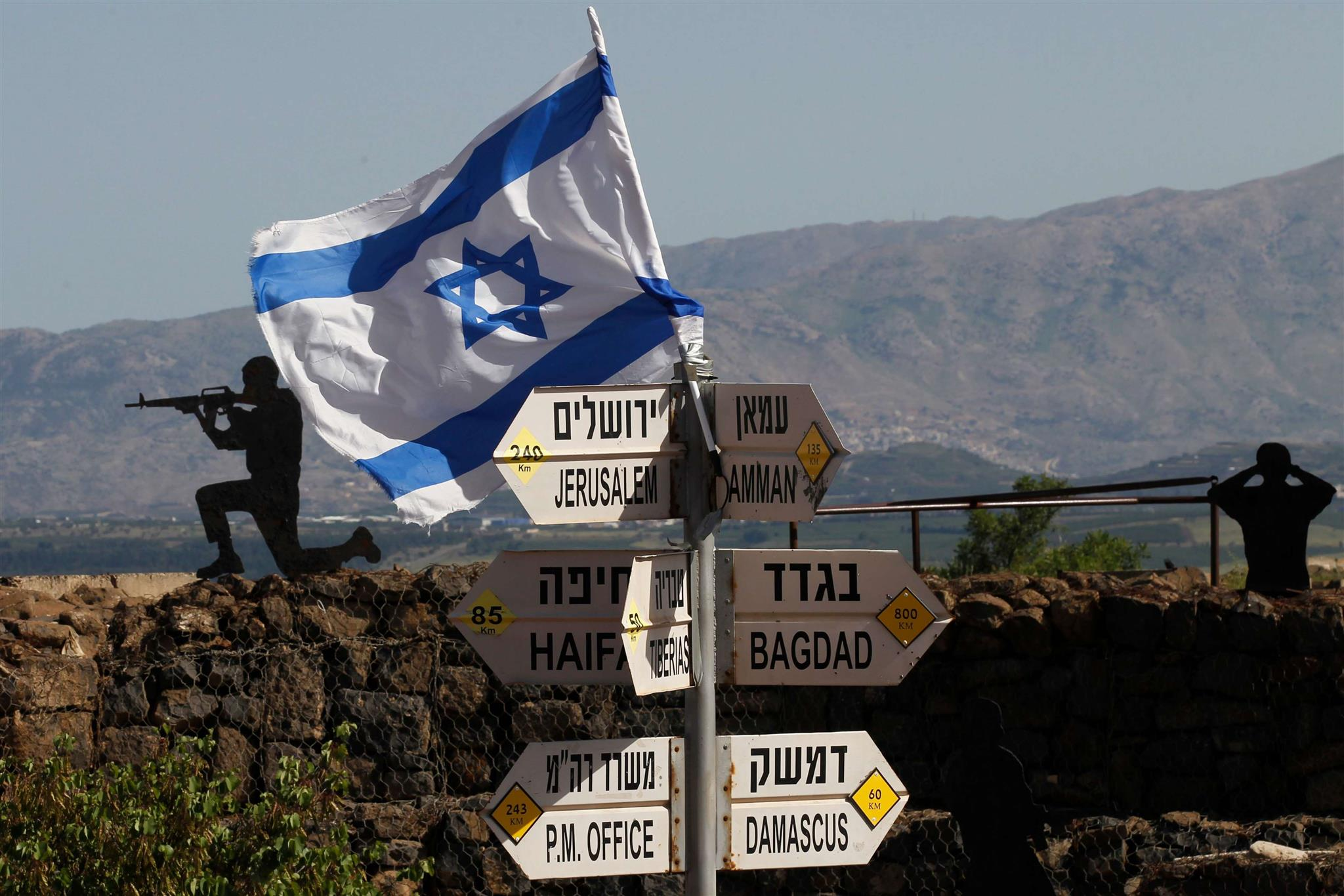 An Israeli flag is seen placed on Mount Bental in the Israeli-annexed Syrian Golan Heights, on May 10. (AFP)