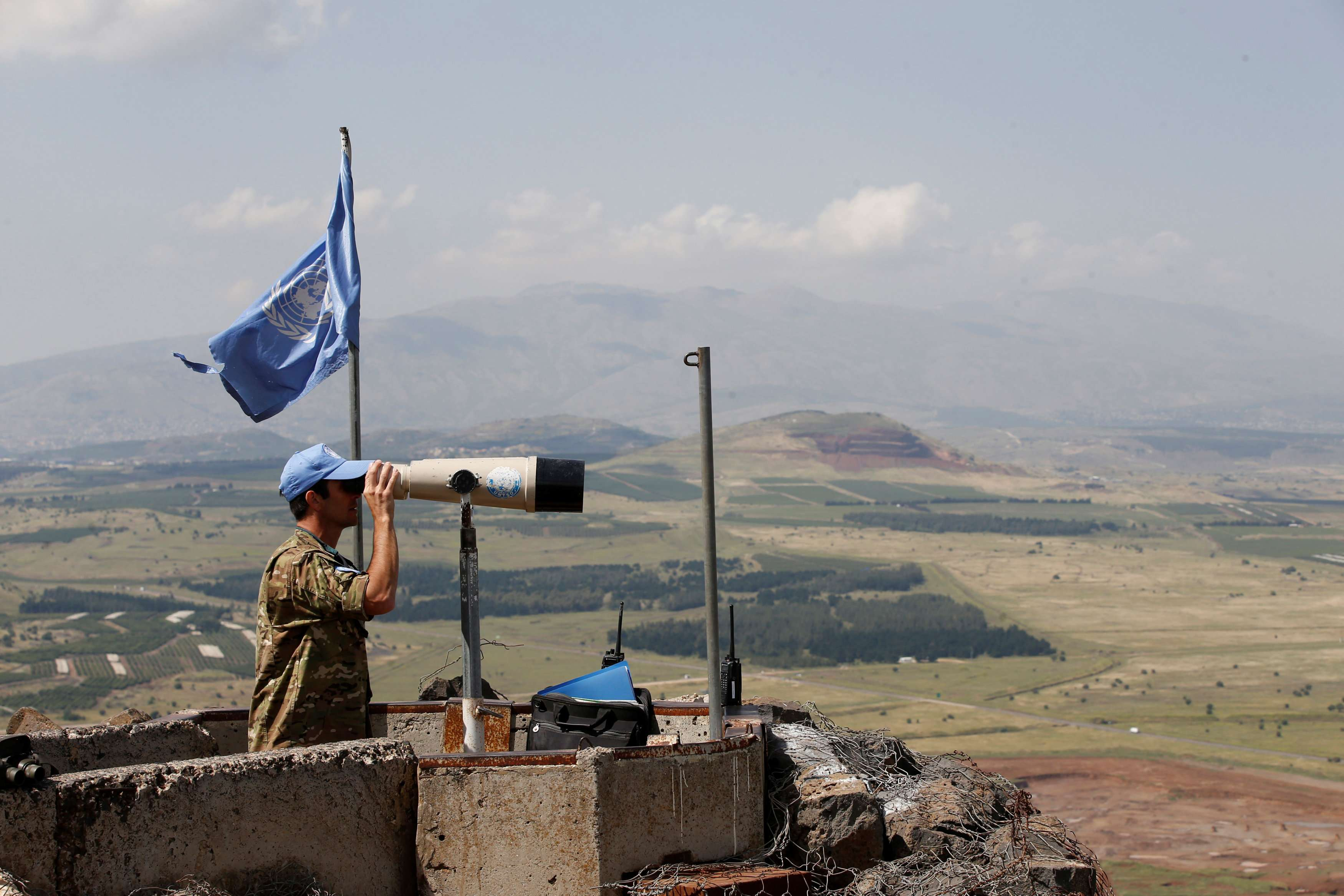 Contested territory. A UN Truce Supervision Organisation observer uses binoculars near the border with Syria in the Israeli-occupied Golan Heights, on May 11. (Reuters)