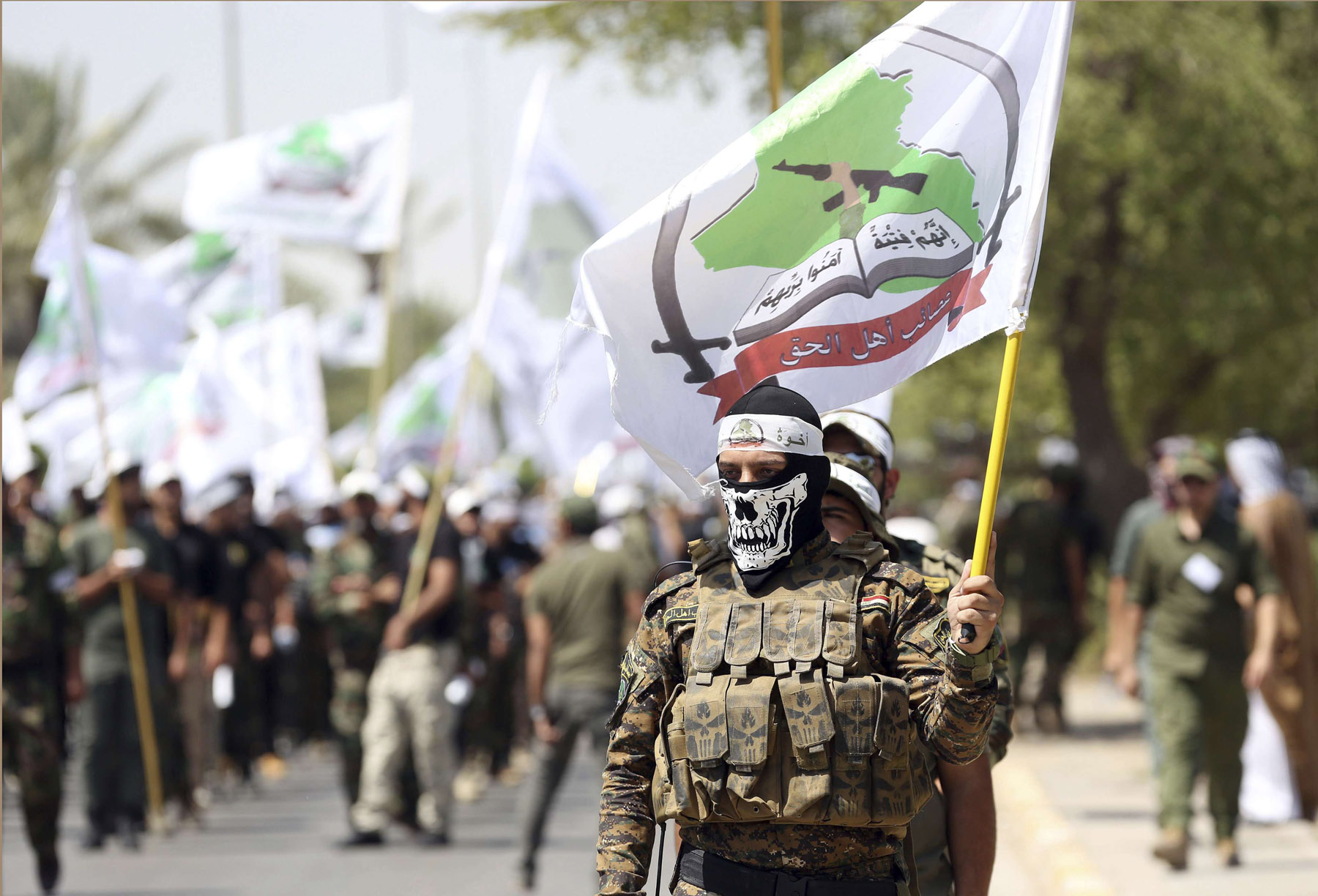 Alarming trend. Members of Shia group Asaib Ahl al-Haq march during the Quds Day gathering in Baghdad, last July. (AP)