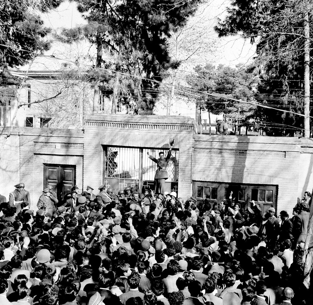 A 1953 file picture shows an army officer rallying a crowd of supporters of Shah Mohammed Reza Pahlevi in front of the home of Iranian Prime Minister Mohammed Mossadegh in Tehran. (AP)