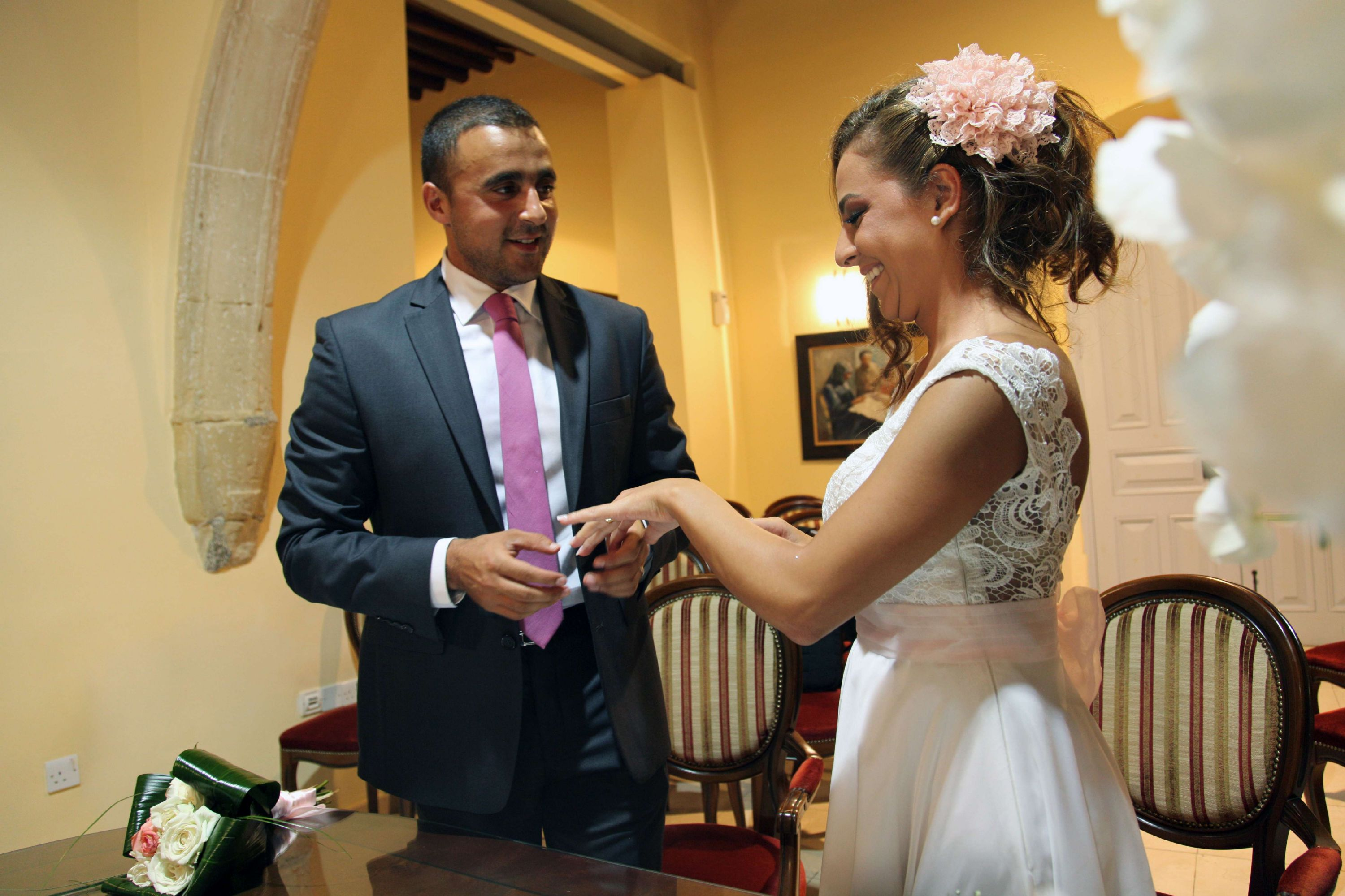 A Middle Eastern couple exchange rings during their wedding ceremony in Cyprus. (AFP)