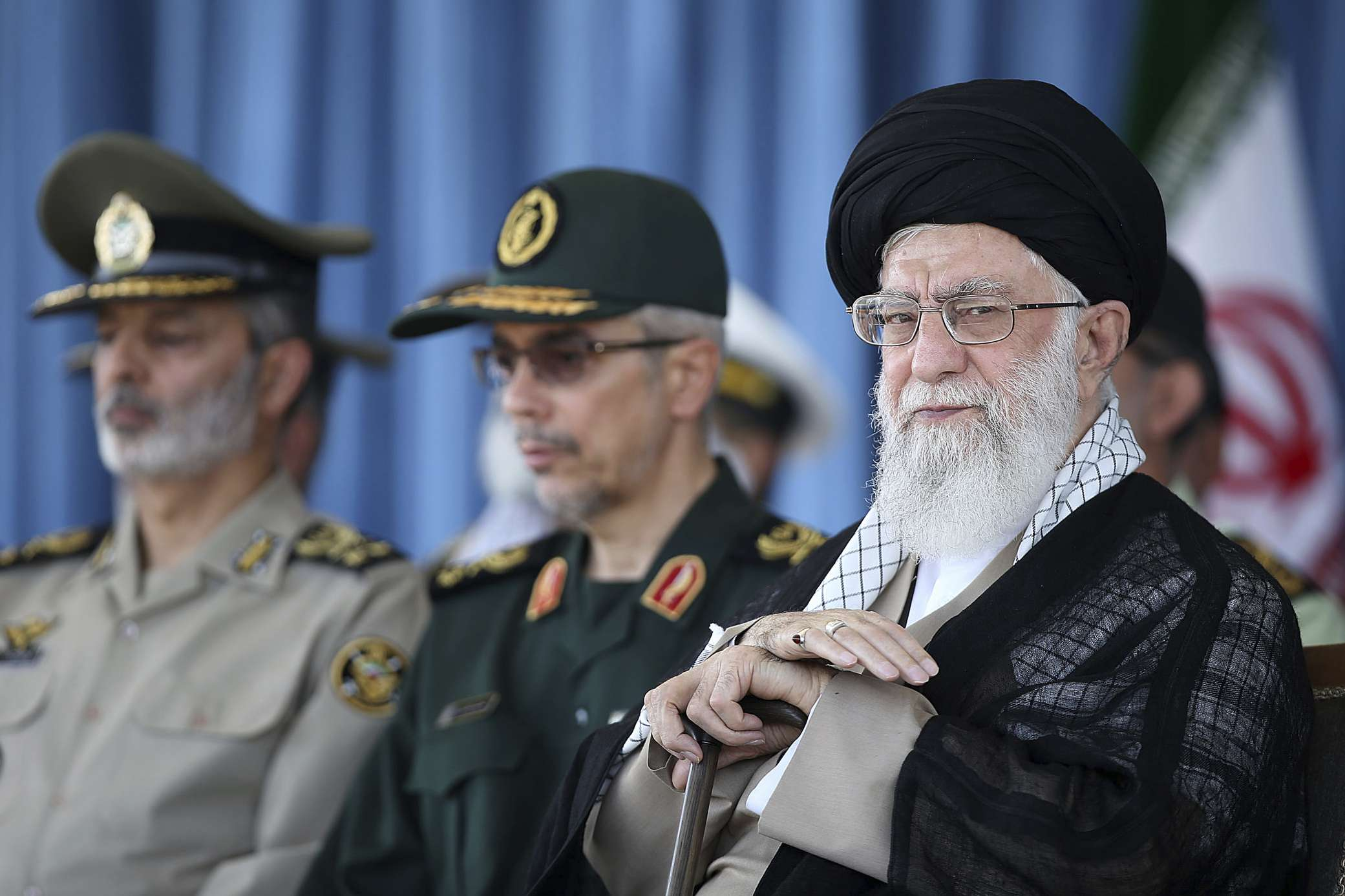 Iranian Supreme Leader Ayatollah Ali Khamenei (R) attends a ceremony at a military academy in Tehran, on June 30. (Office of the Iranian Supreme Leader)