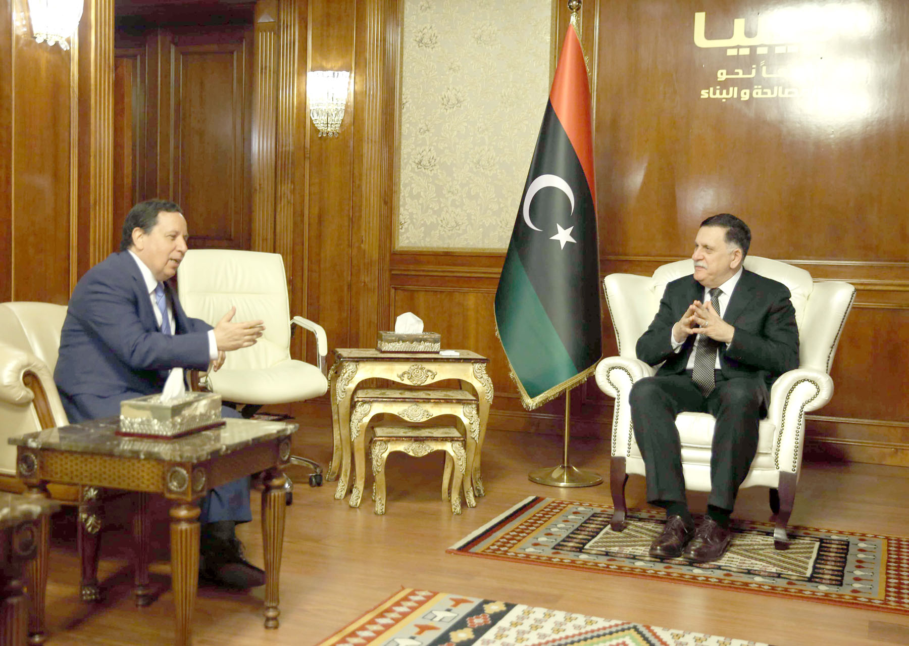 New push. Libyan Prime Minister Fayez al-Sarraj, head of the UN-backed government in Tripoli (R), meets with Tunisian Foreign Minister Khemaies Jhinaoui in Tripoli. (AFP)