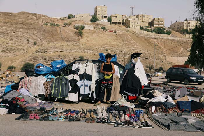 Narrowing horizons. A boy sells second-hand items in Amman, on June 7.                                                                                                            (Reuters)