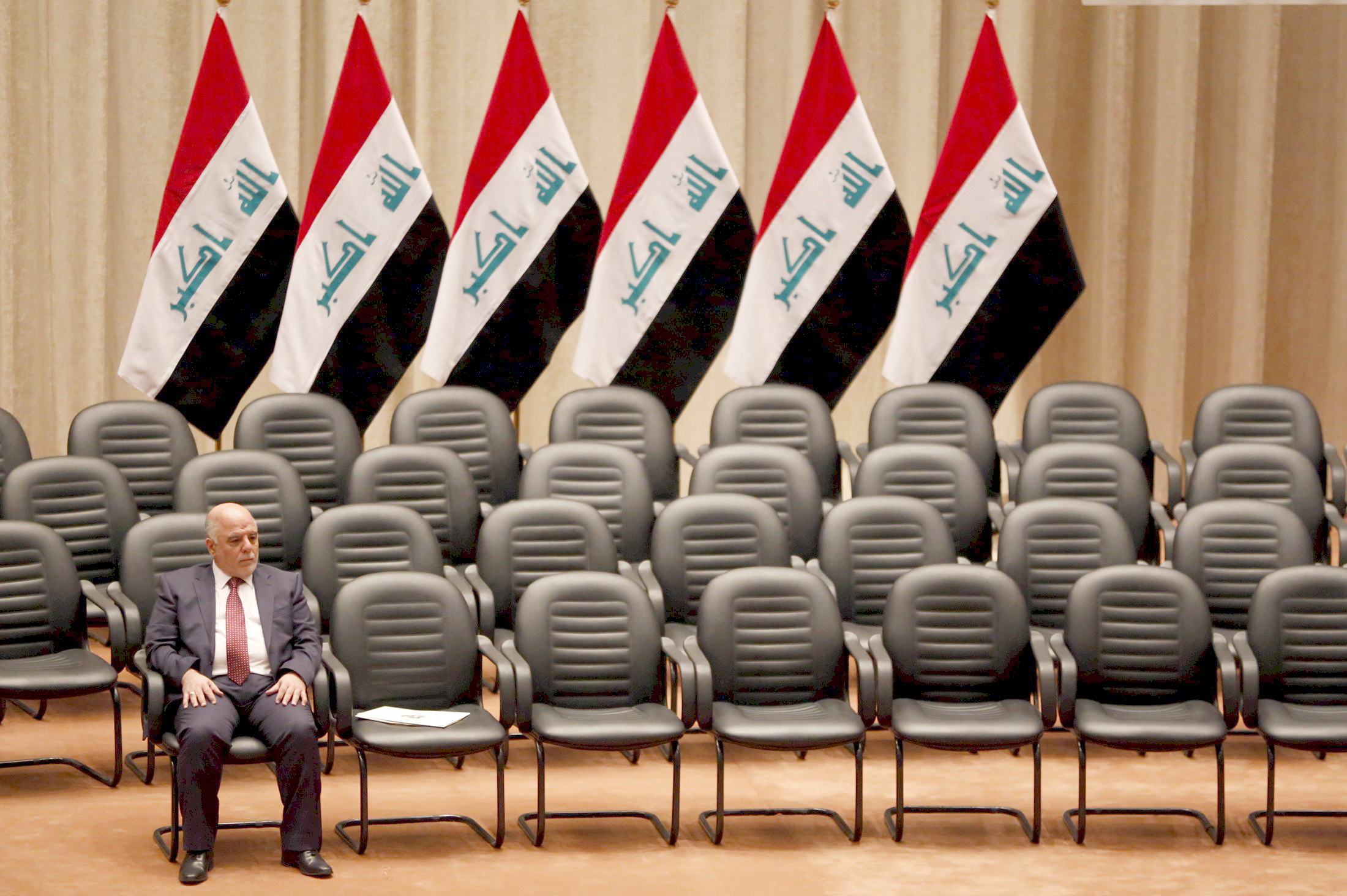 For the time being. A file picture shows Iraq's Prime Minister Haider al-Abadi sitting during a session at the parliament headquarters in Baghdad. (Reuters)