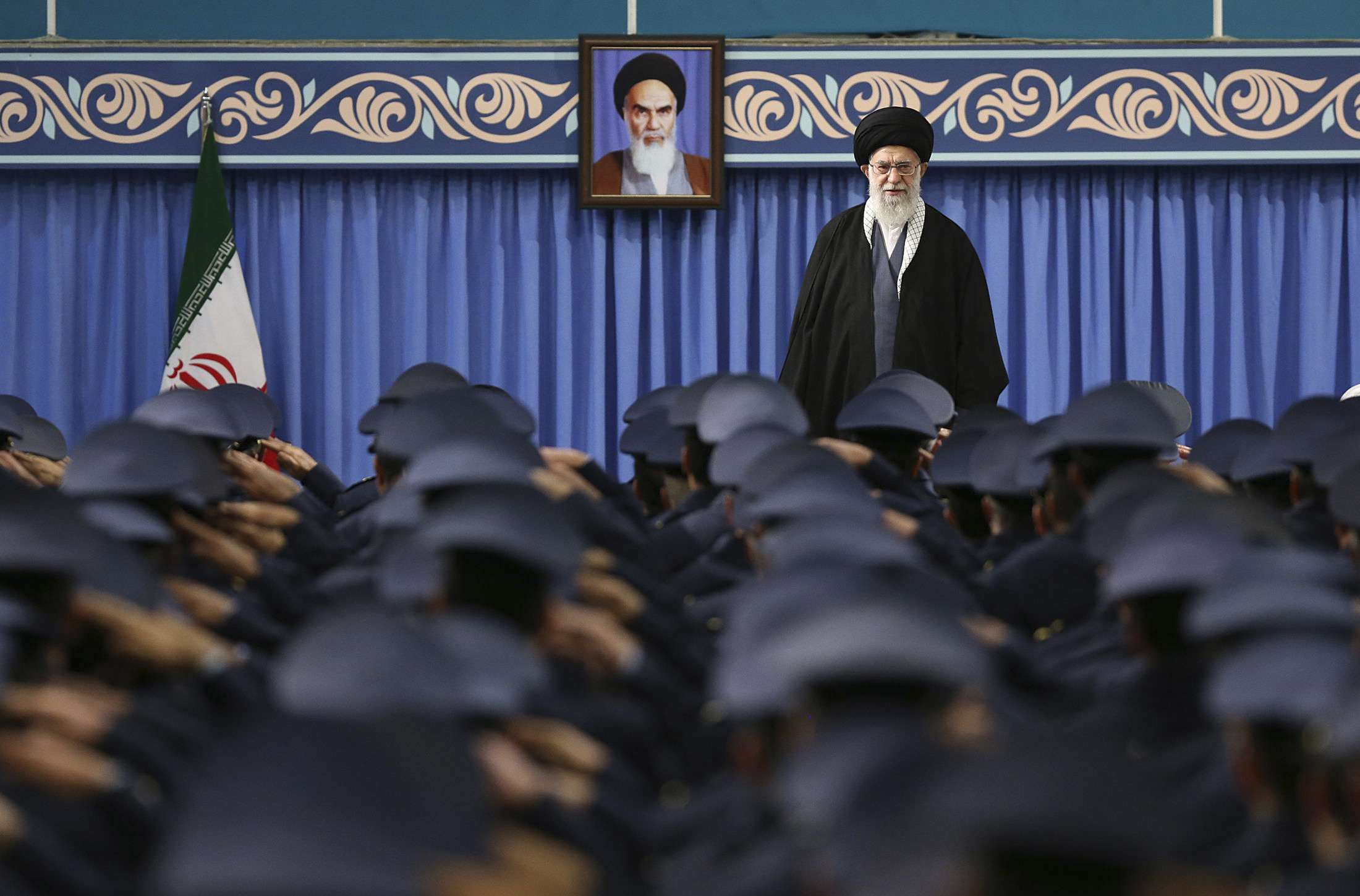 Iranian Supreme Leader Ayatollah Ali Khamenei stands as army staff salute at the start of a meeting in Tehran, last February. (AP)
