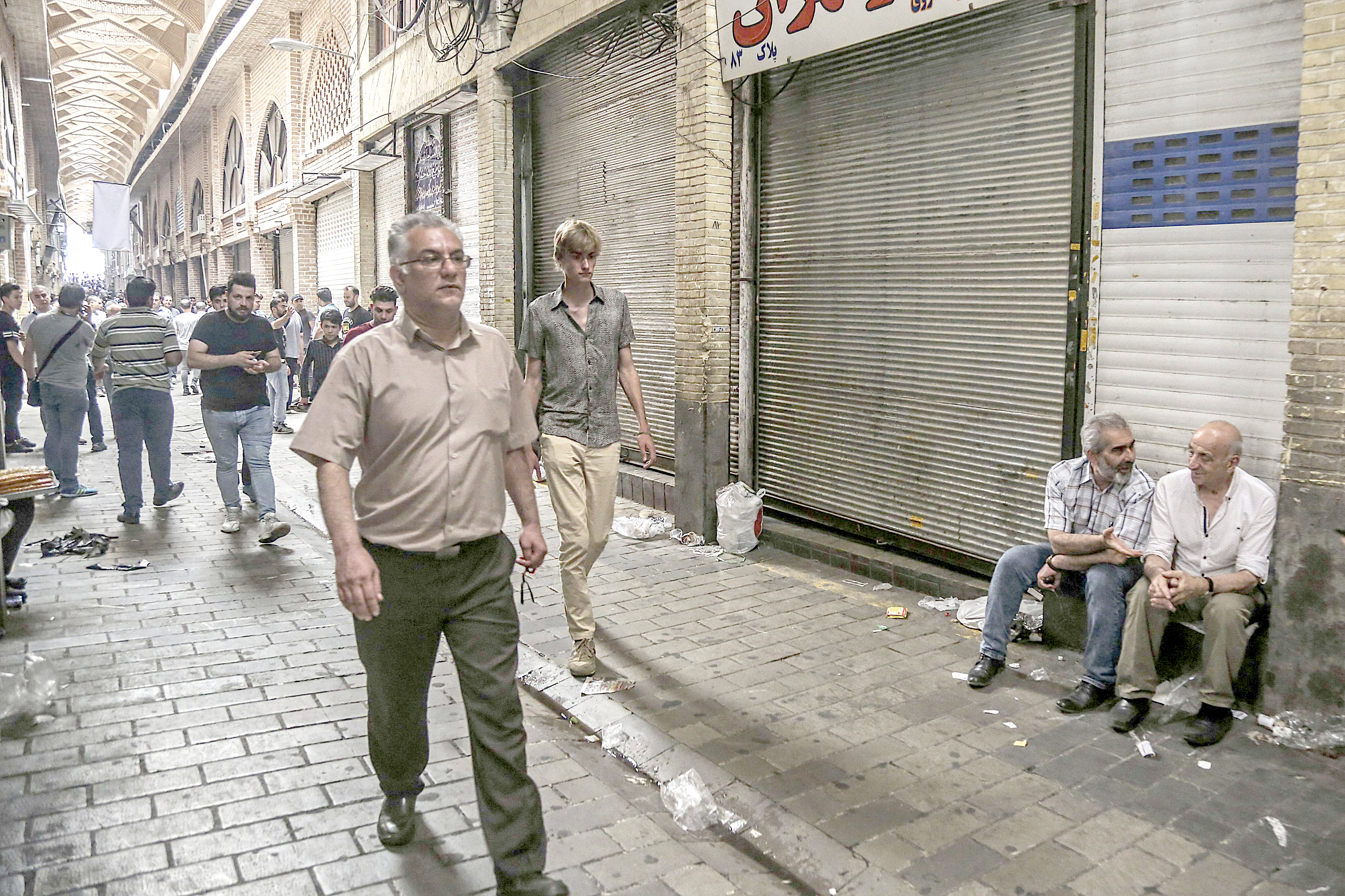 Genuine grievances. People walk through the old Grand Bazaar where shops are closed after a protest, on June 25. (AP)