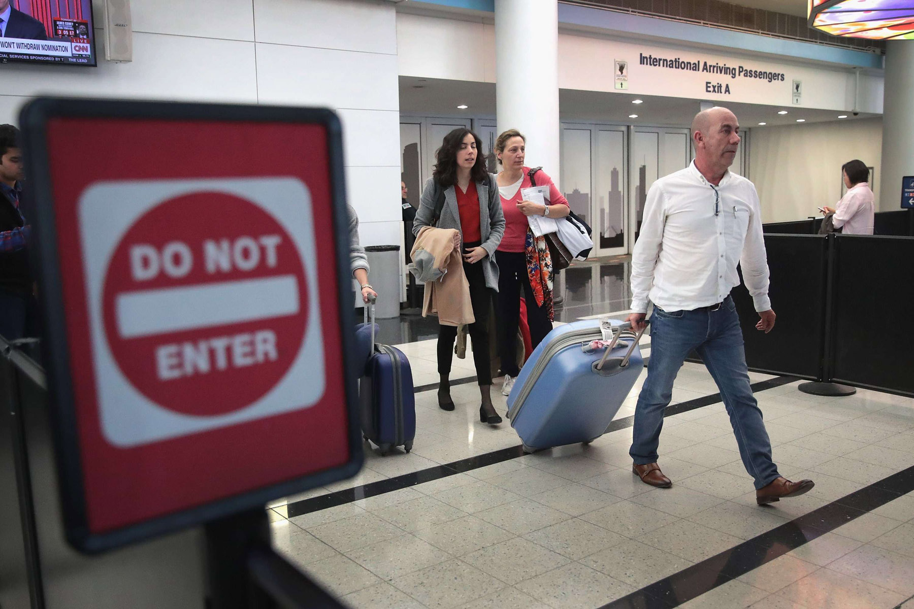 Travellers arrive at the international terminal of O'Hare International Airport in Chicago. (AFP)