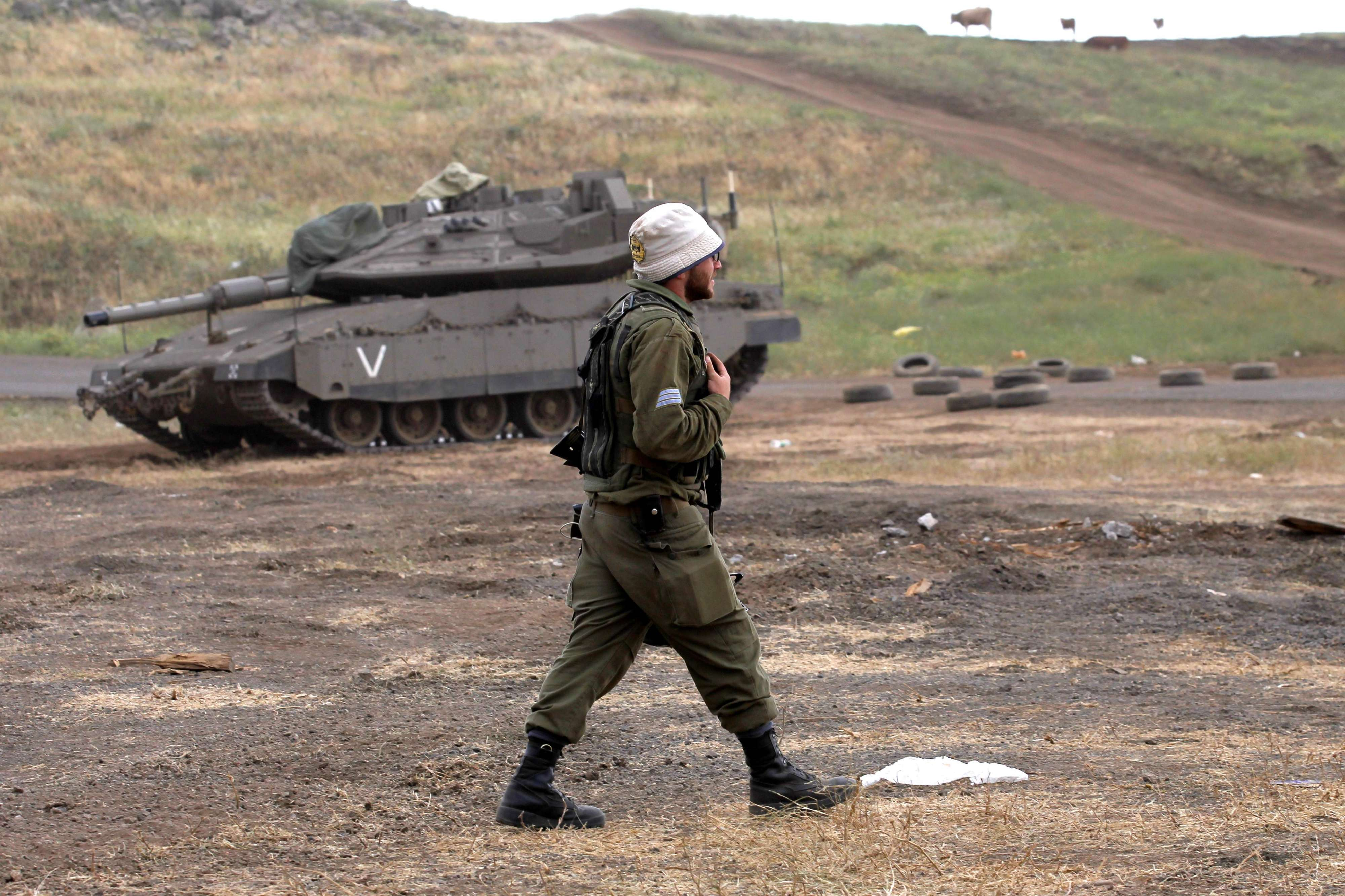 Old tactics. An Israeli soldier attends a planned military drill next to a Merkava Mark IV tank in the Israeli-annexed Golan Heights, last May. (AFP)