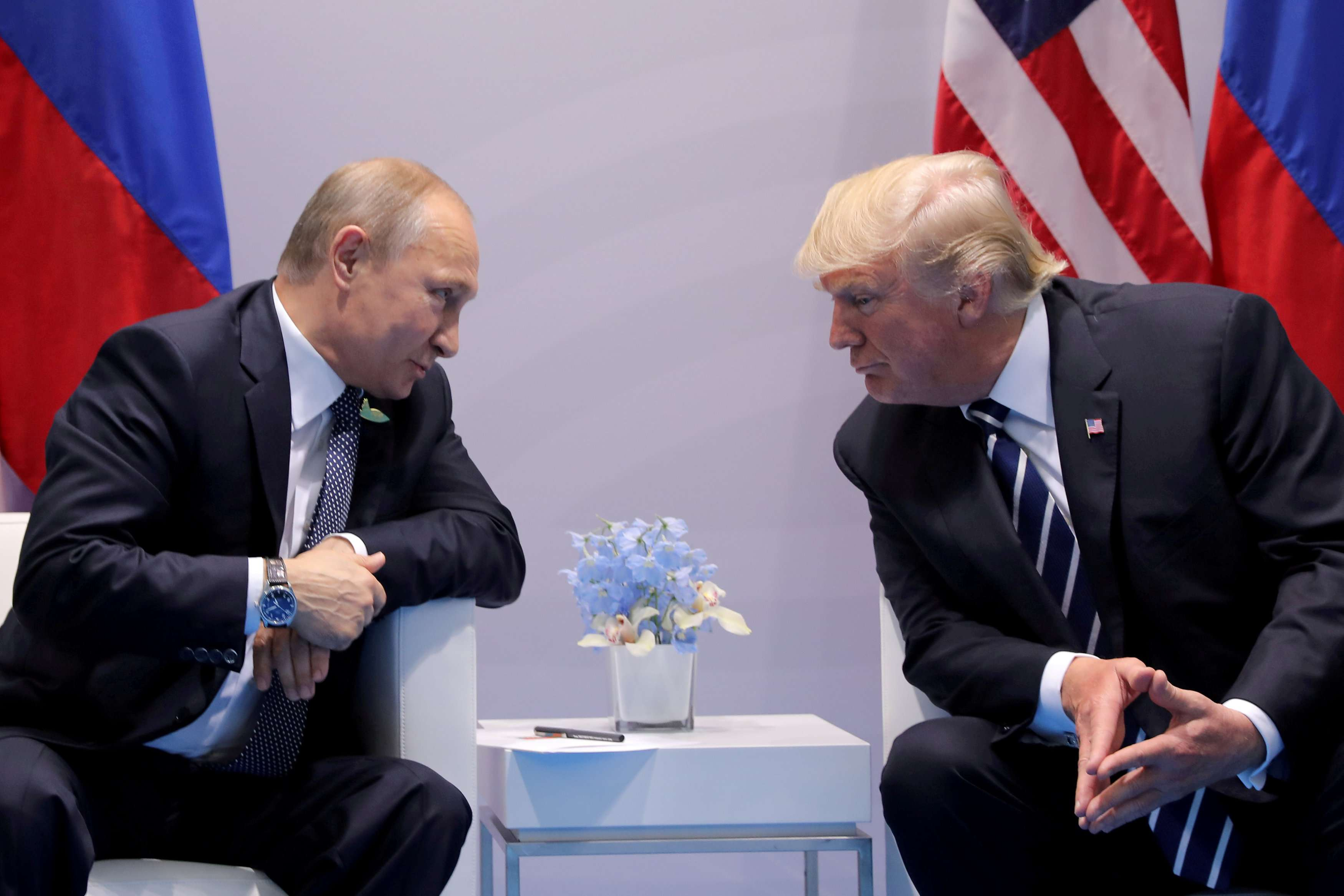 Russian President Vladimir Putin (L) talks to US President Donald Trump during their meeting at the G20 summit in Hamburg, last July. (Reuters)