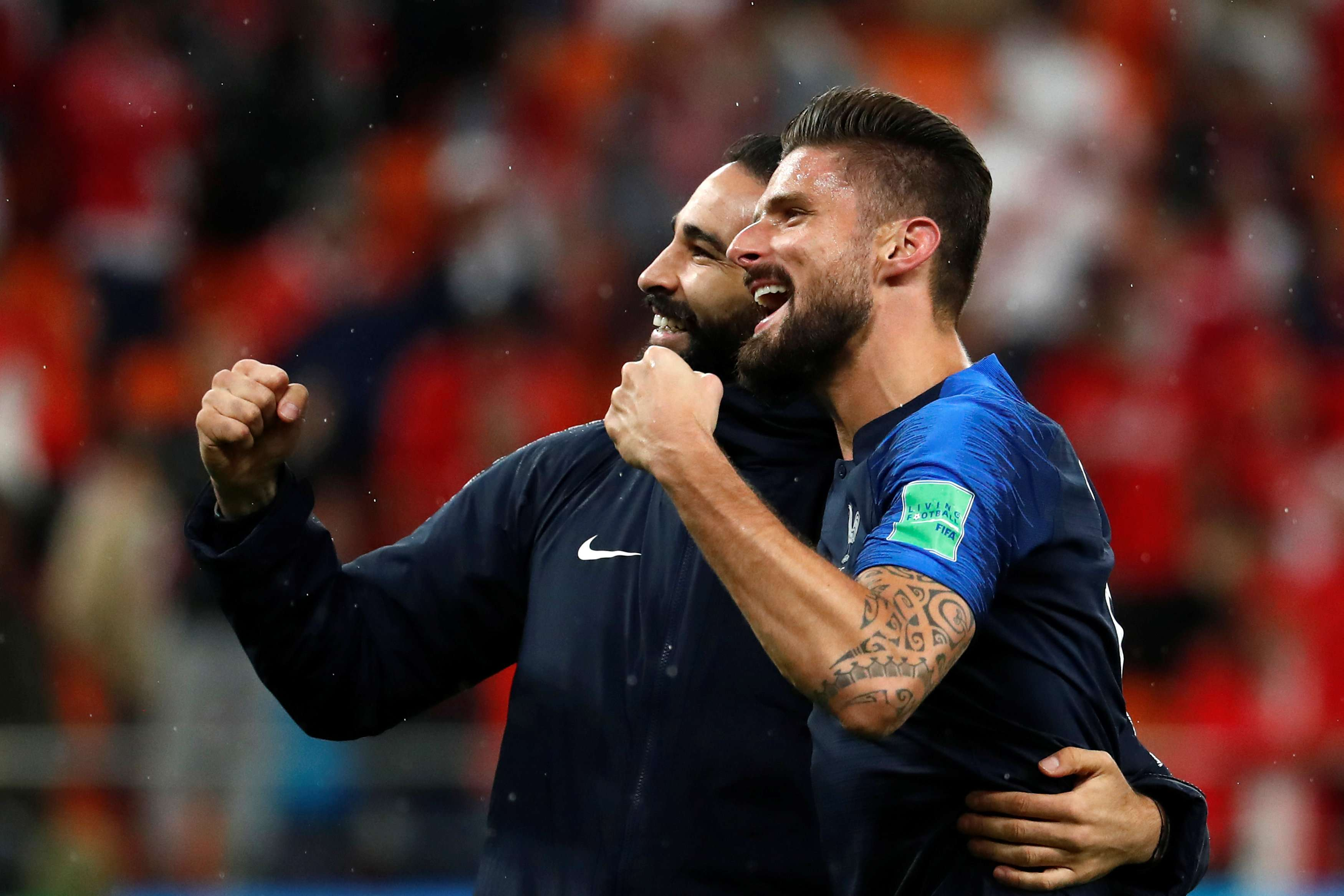 Adil Rami (L) and Olivier Giroud celebrate victory after France's game against Peru, on June 21. (Reuters)