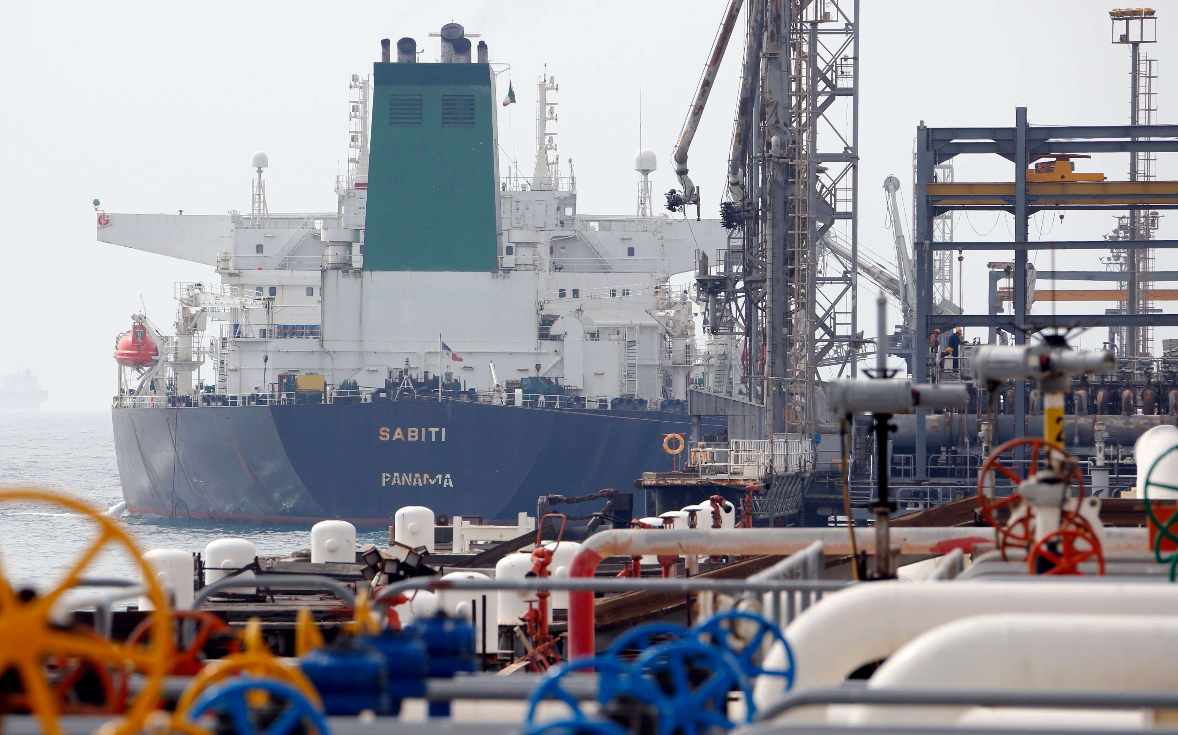 A tanker docks at the platform of an Iranian oil facility in the Khark Island. (AFP)