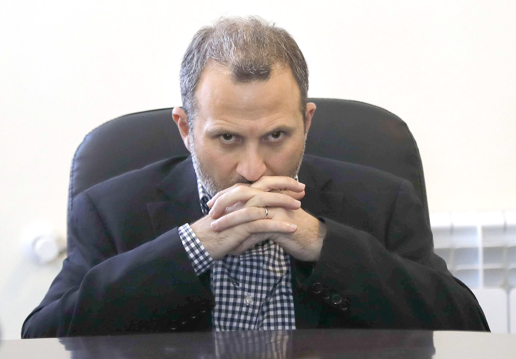 Lebanese Foreign Minister Gebran Bassil pauses during a news conference in Arsal near the border with Syria, last June. (AP)