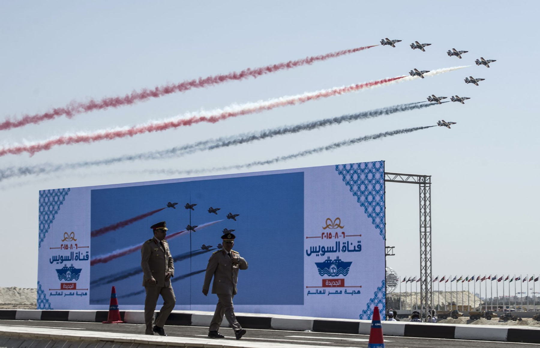 Increasing role. A file picture shows Egyptian Army officers  walking in front of a huge screen during the opening ceremony of a waterway at the Suez Canal in Ismailia. (AFP)