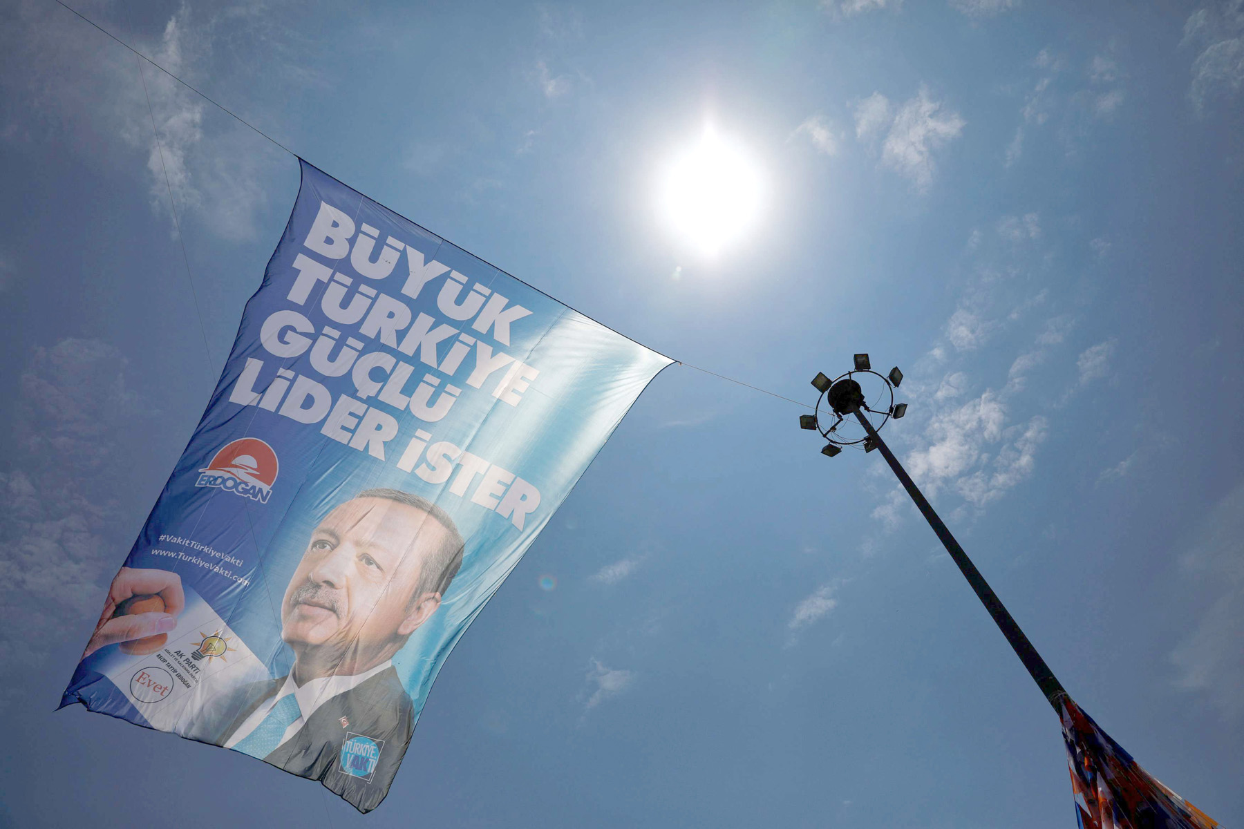 Up in the air. An election poster of Turkish President Recep Tayyip Erdogan at a rally in Istanbul, last June. (Reuters)