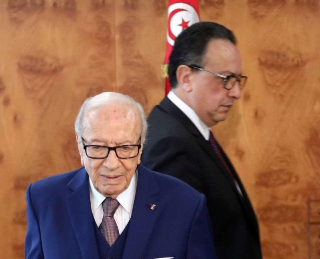 Tunisian President Beji Caid Essebsi (Front) and Hafedh Caid Essebsi, the head of Nidaa Tounes arrive for a meeting at Carthage Palace in Tunis, last May. (Reuters)
