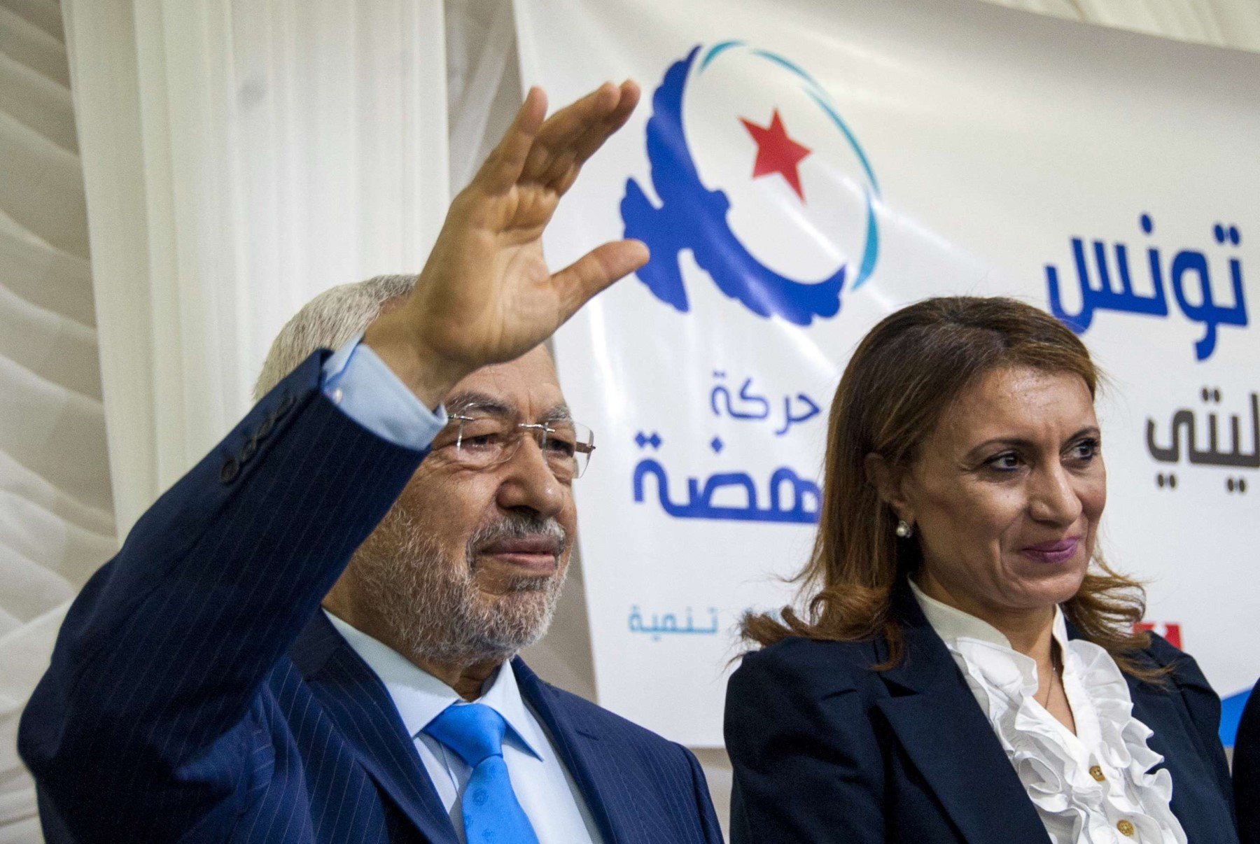 Souad Abderrahim, 54, right, campaigns with Rached Ghannouchi, head of Islamist party Ennahdha, in Tunis, on April 14. (AP)