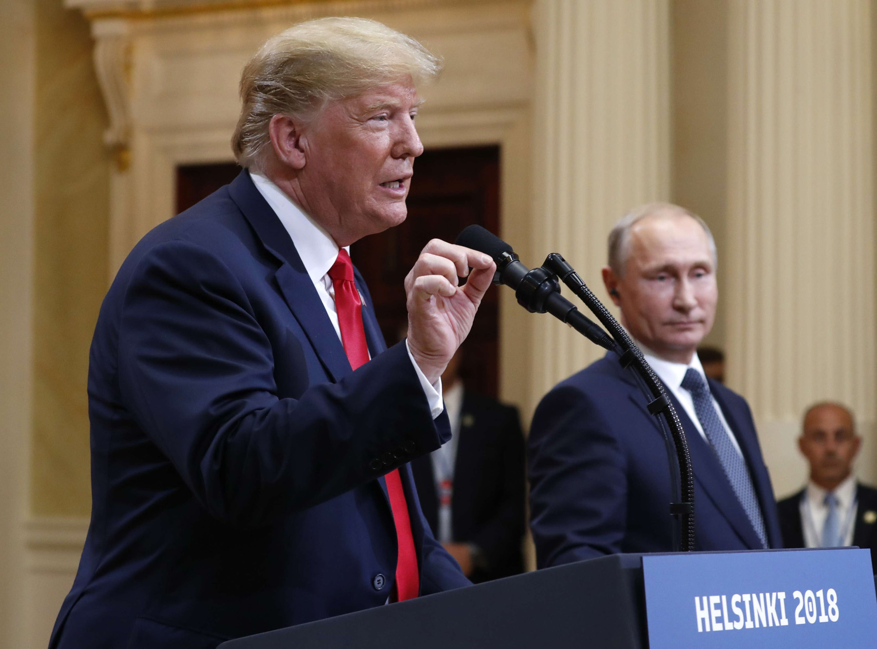 US President Donald Trump speaks with Russian President Vladimir Putin during a news conference in Helsinki, on July 16. (AP)