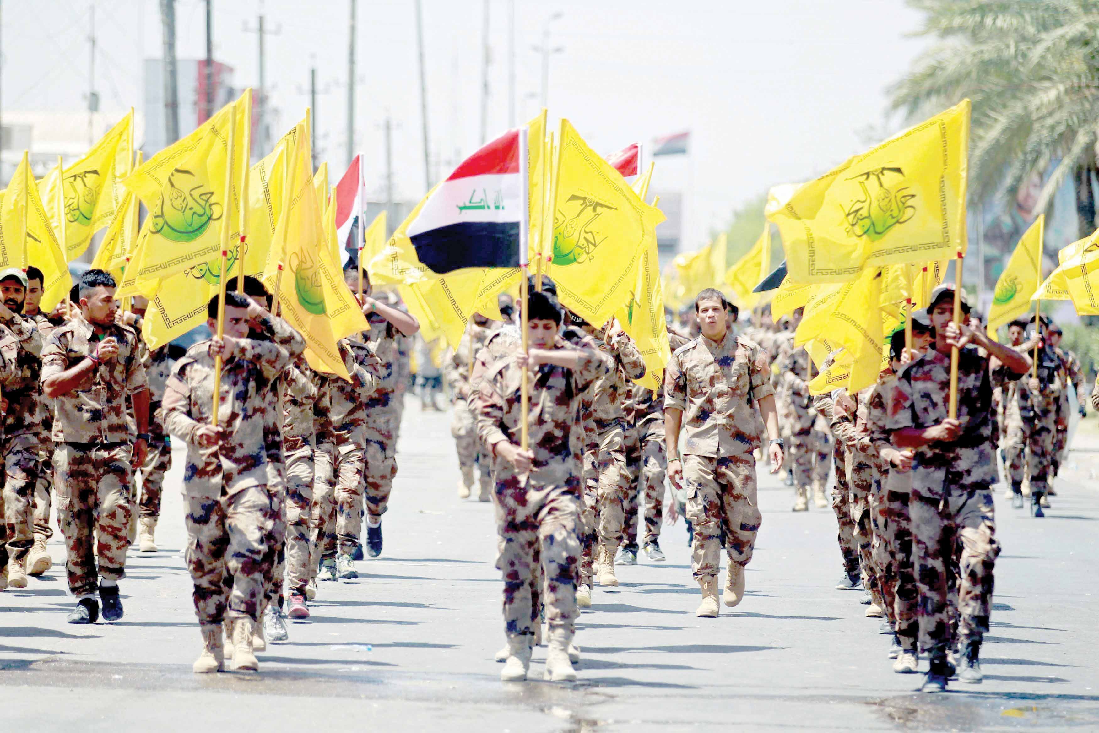 No democrats. Iran-backed fighters march during a parade in Baghdad.  (Reuters)