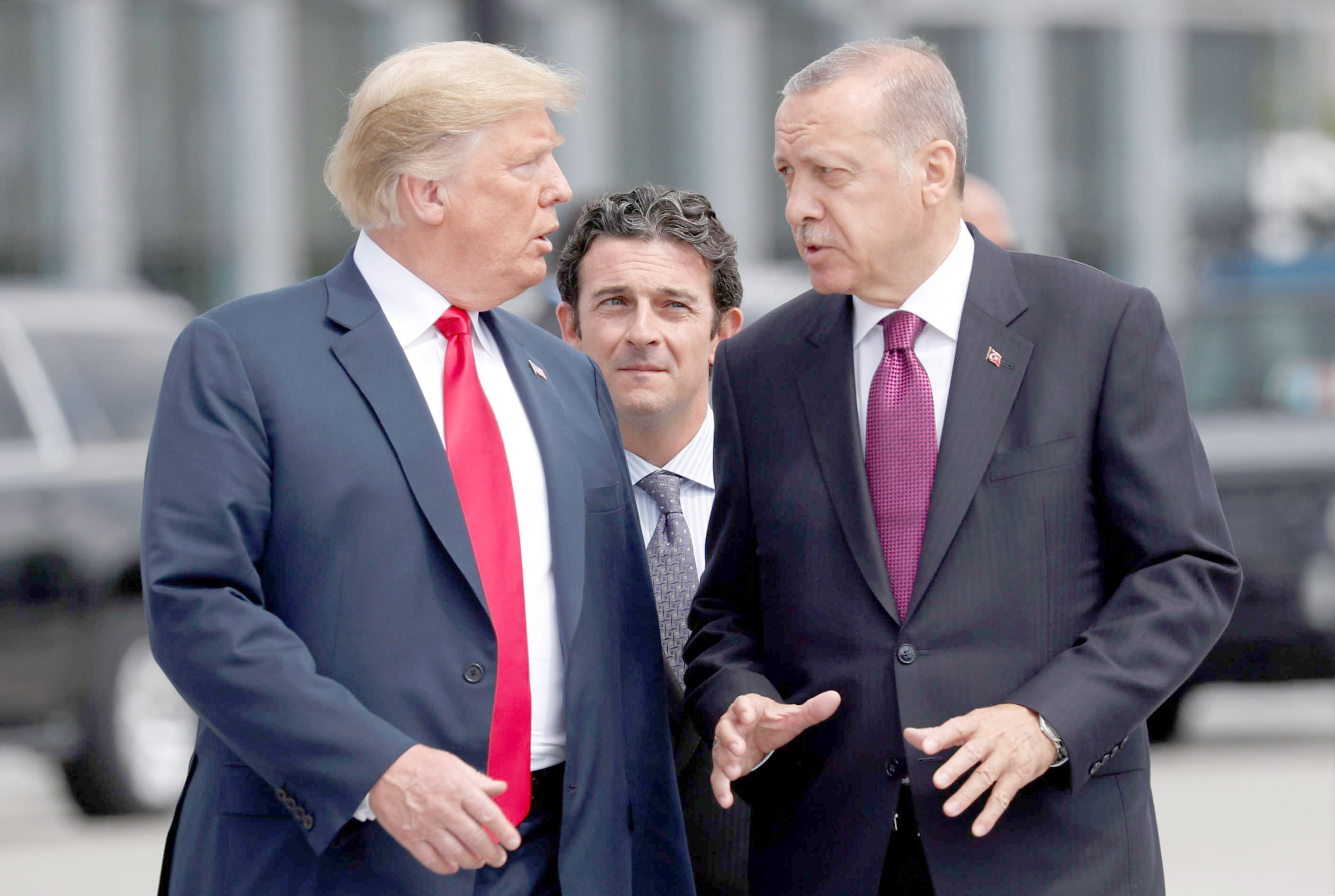 US President Donald Trump (L) and Turkish President Recep Tayyip Erdogan talk at the start of the NATO summit in Brussels, on July 11. (Reuters)