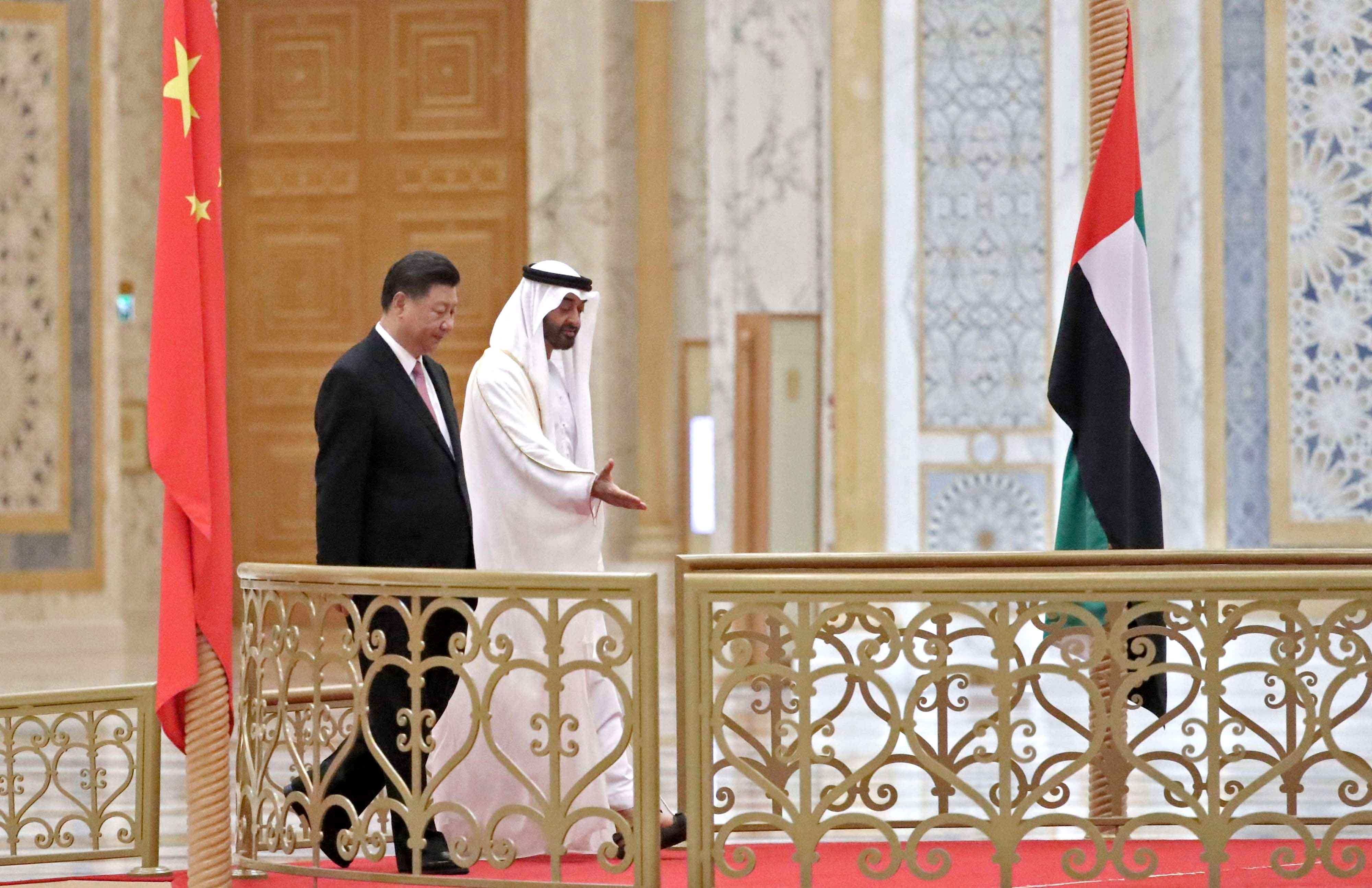 Chinese President Xi Jinping (L) and Abu Dhabi Crown Prince Sheikh Mohammed bin Zayed al-Nahyan arrive at the presidential palace in Abu Dhabi, on July 20. (AFP)