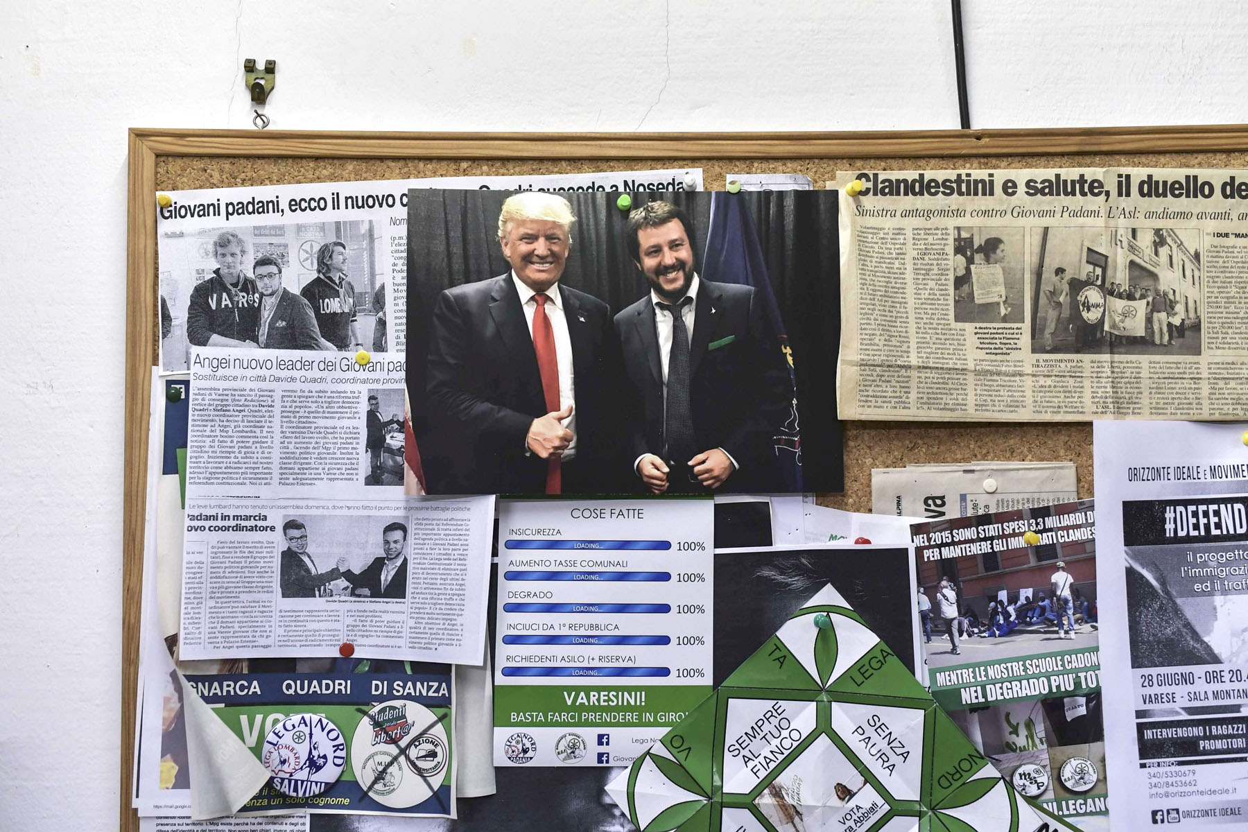 A picture of  Italian Interior Minister and deputy Prime Minister Matteo Salvini (R) and US President Donald Trump is pinned on a board at the office of the Italian far-right party, the Lega,  in Varese. (AFP)
