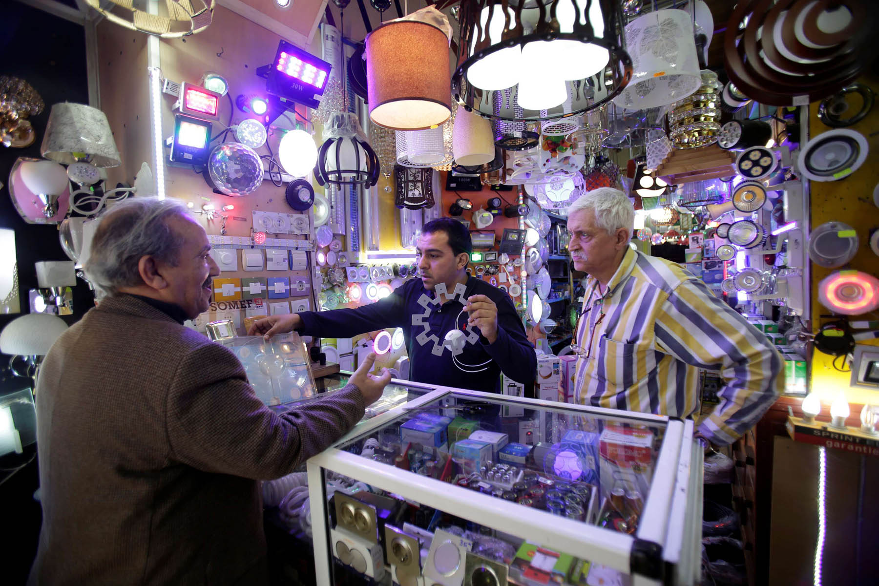 A customer buys a light bulb at a lighting store in Algiers. (Reuters)