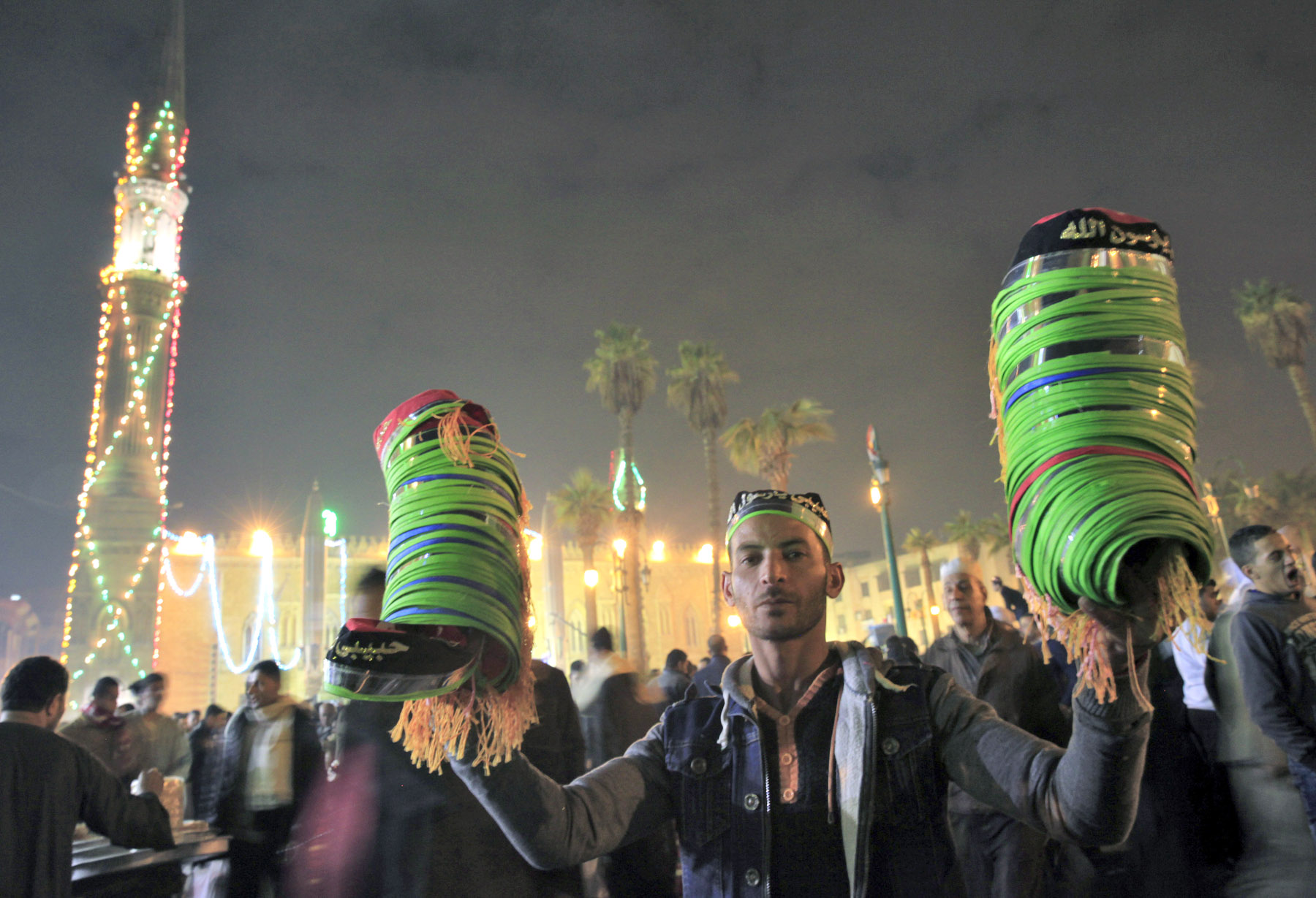 Out of need. An Egyptian street vendor sells traditional hats in Old Cairo. (Reuters)