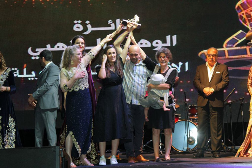 For the love of cinema. Algerian director Yasmine Chouikh (3rd L) receives the Golden Dawn prize at the Oran International Arabic Film Festival.    (Oran International Arabic Film Festival)