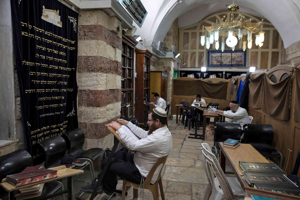 Jews study the Torah at the Patriarchs' Tomb in the the divided West Bank city of Hebron. (AFP)