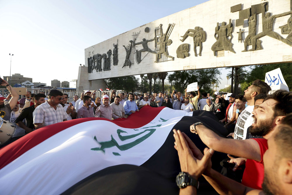 Iraqis take part in a demonstration in Baghdad's Tahrir Square, on July 31. (AP)