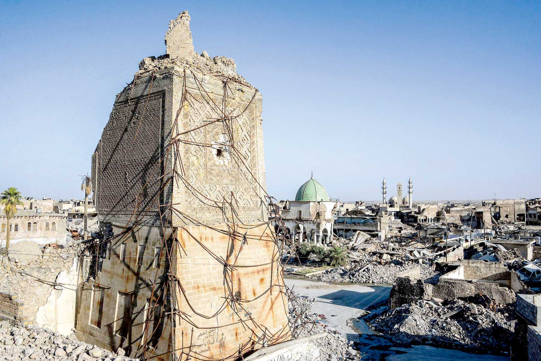 "The base of the destroyed ""Al-Hadba"" leaning minaret and the dome of the destroyed Al-Nuri Mosque in the Old City of Mosul, on July 9. (AFP)"