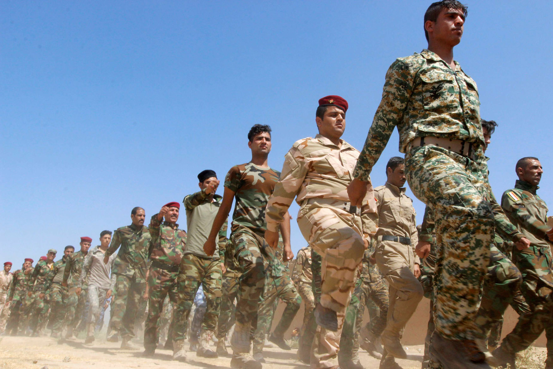 Fighters of the Popular Mobilisation Forces (PMF) march during a military parade in Daquq. (Reuters)