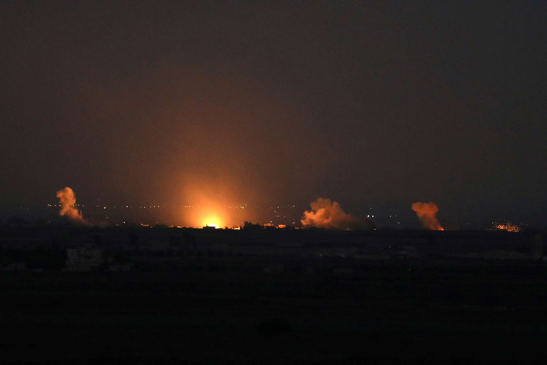 Fire follows an explosion at the Syrian side of the Israeli Syrian border as it is seen from the Israeli-occupied Golan Heights. (Reuters)