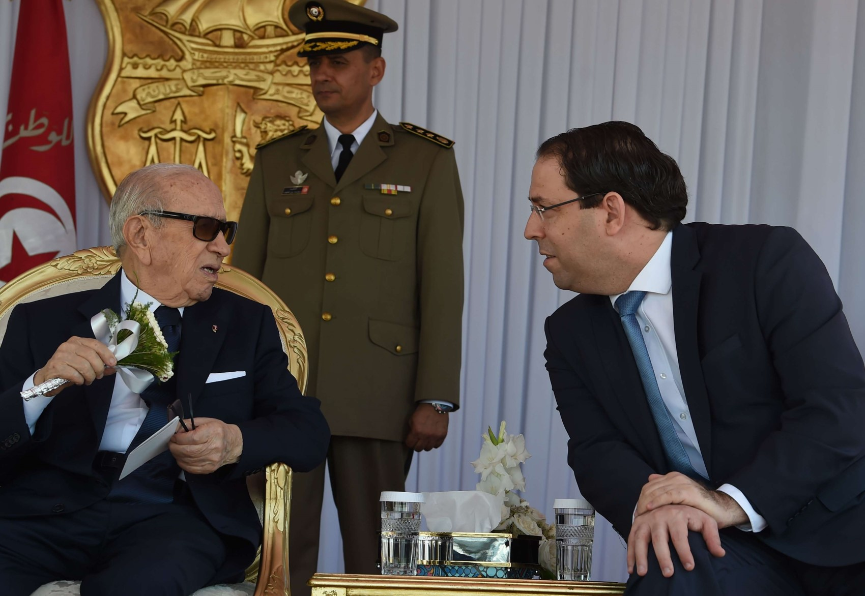 Tunisian President Beji Caid Essebsi(L) and Prime Minister Youssef Chahed attend the Tunisian naval forces military intervention drill on June 25, 2018 at the port of La Goulette in capital Tunis. (AFP)