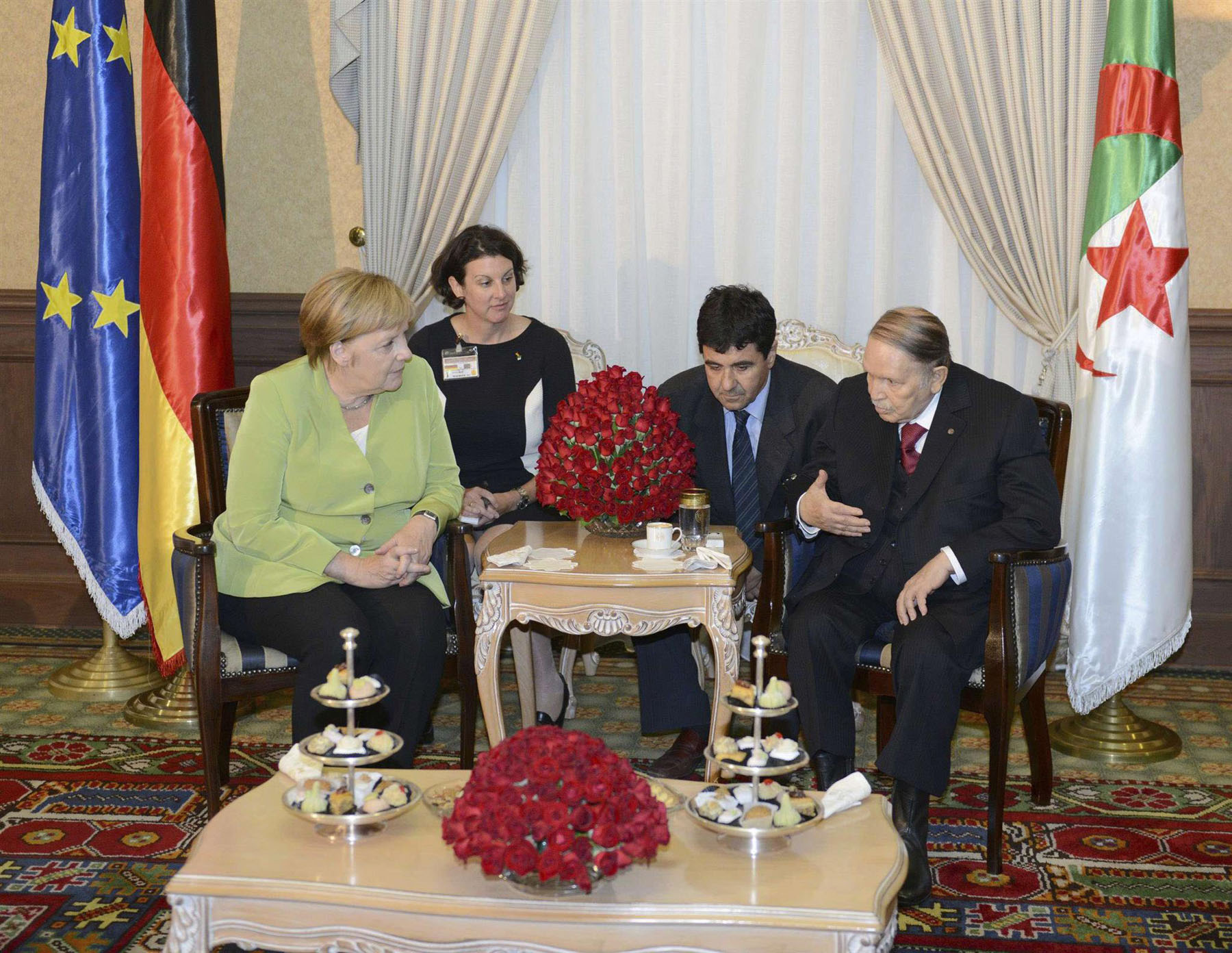Algerian President Abdelaziz Bouteflika (R) meets with visiting German Chancellor Angela Merkel in Algiers, on September 17. (Algerian Presidential Palace)