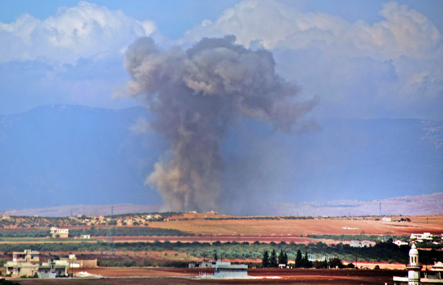 Smoke raises in the Syrian village of Kafr Ain in the southern Idlib province after an air strike on September 7.        (AFP)